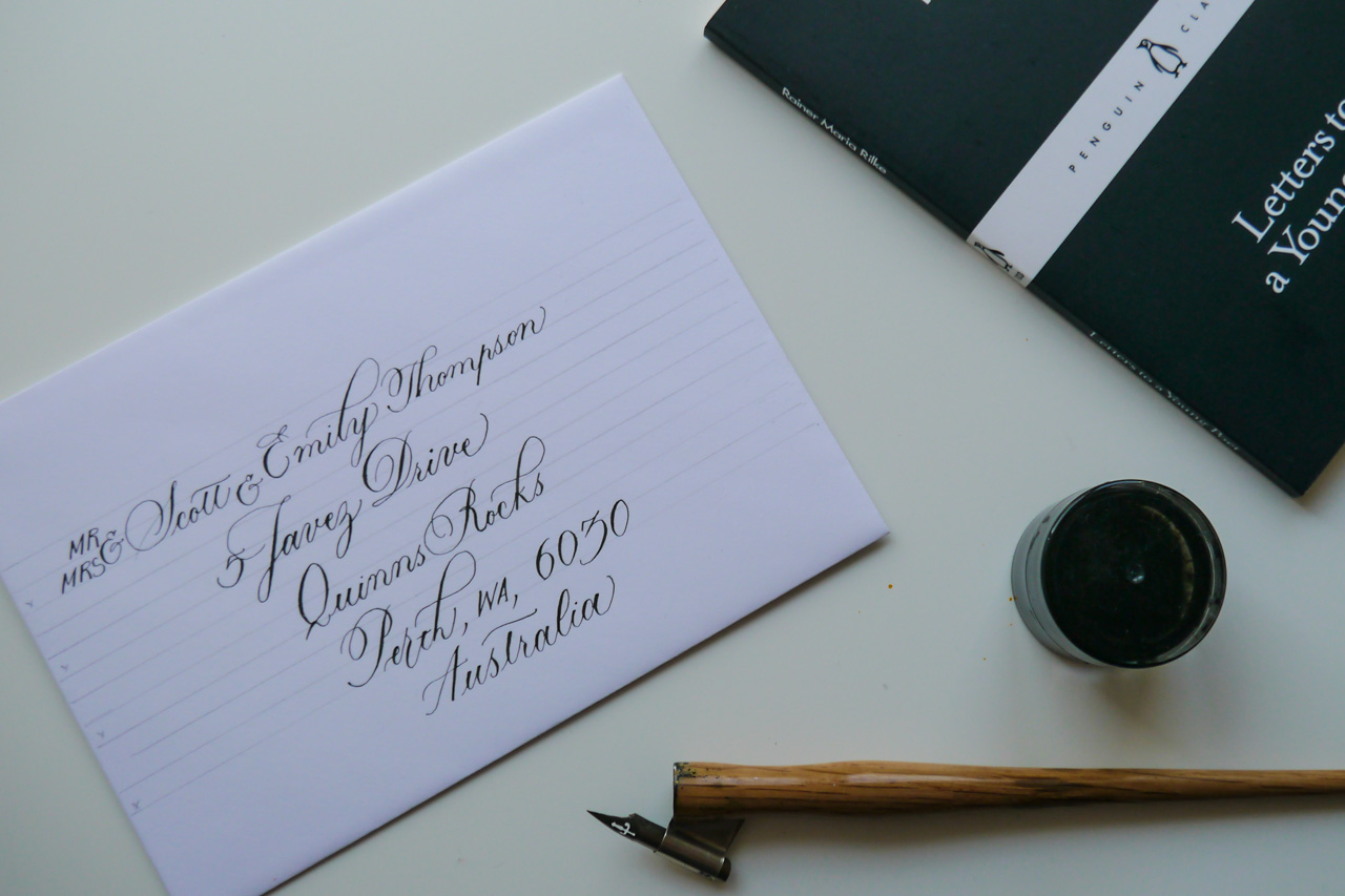 using a lettering template to address envelopes in copperplate calligraphy