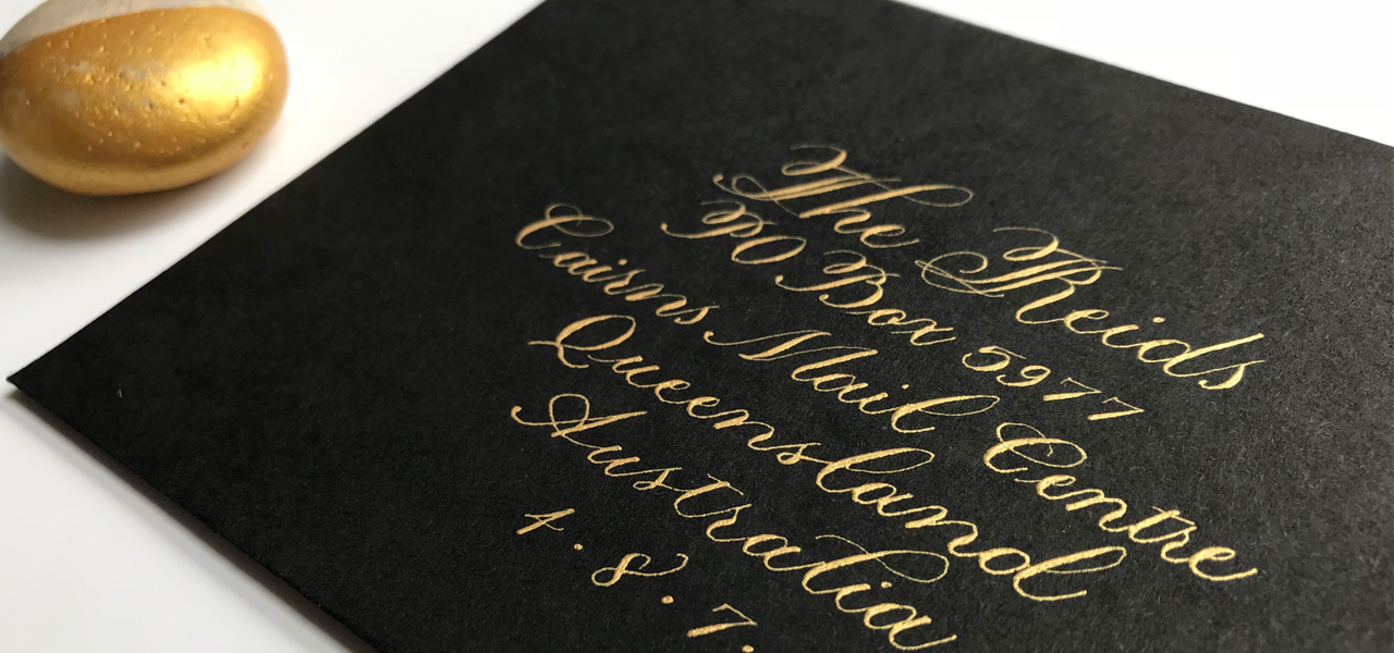 Dr Ph Martin's Copper Plate Gold Iridescent Ink on black A6 envelope