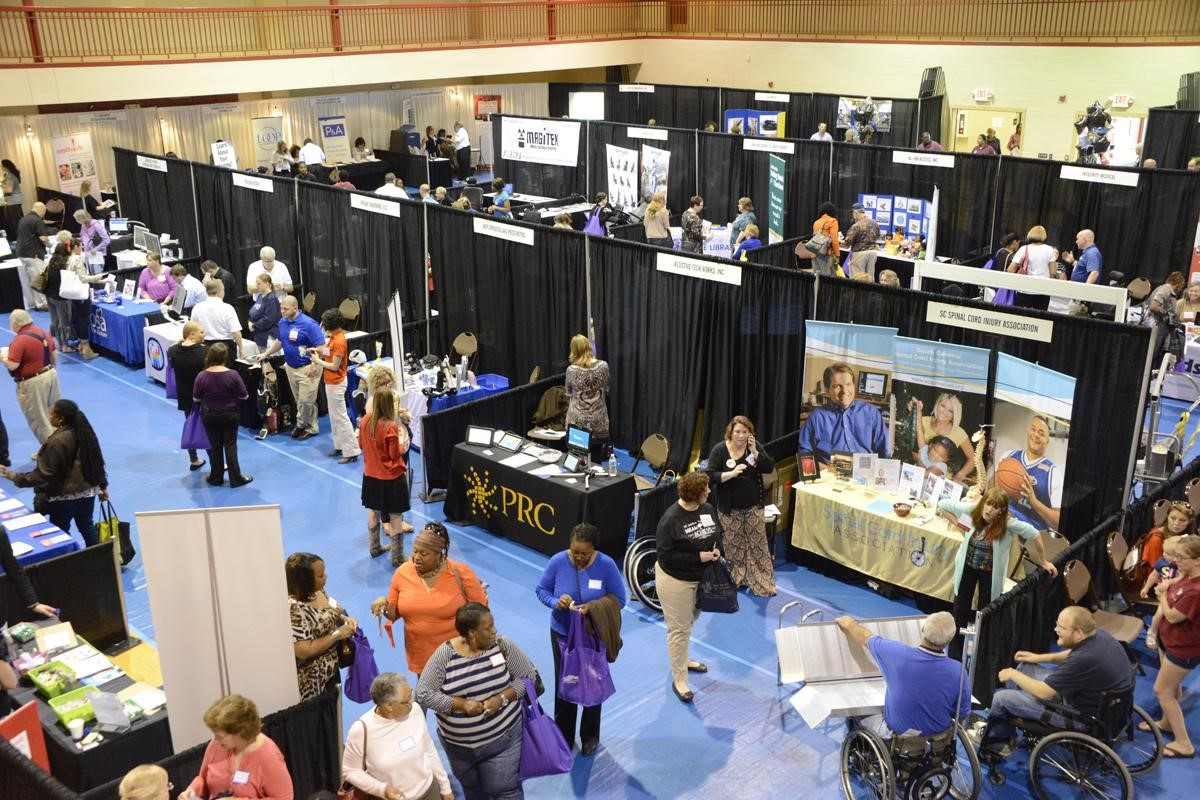 Overhead shot of a past year's SC Assistive Technolgoy Expo with people at different vendor booths.