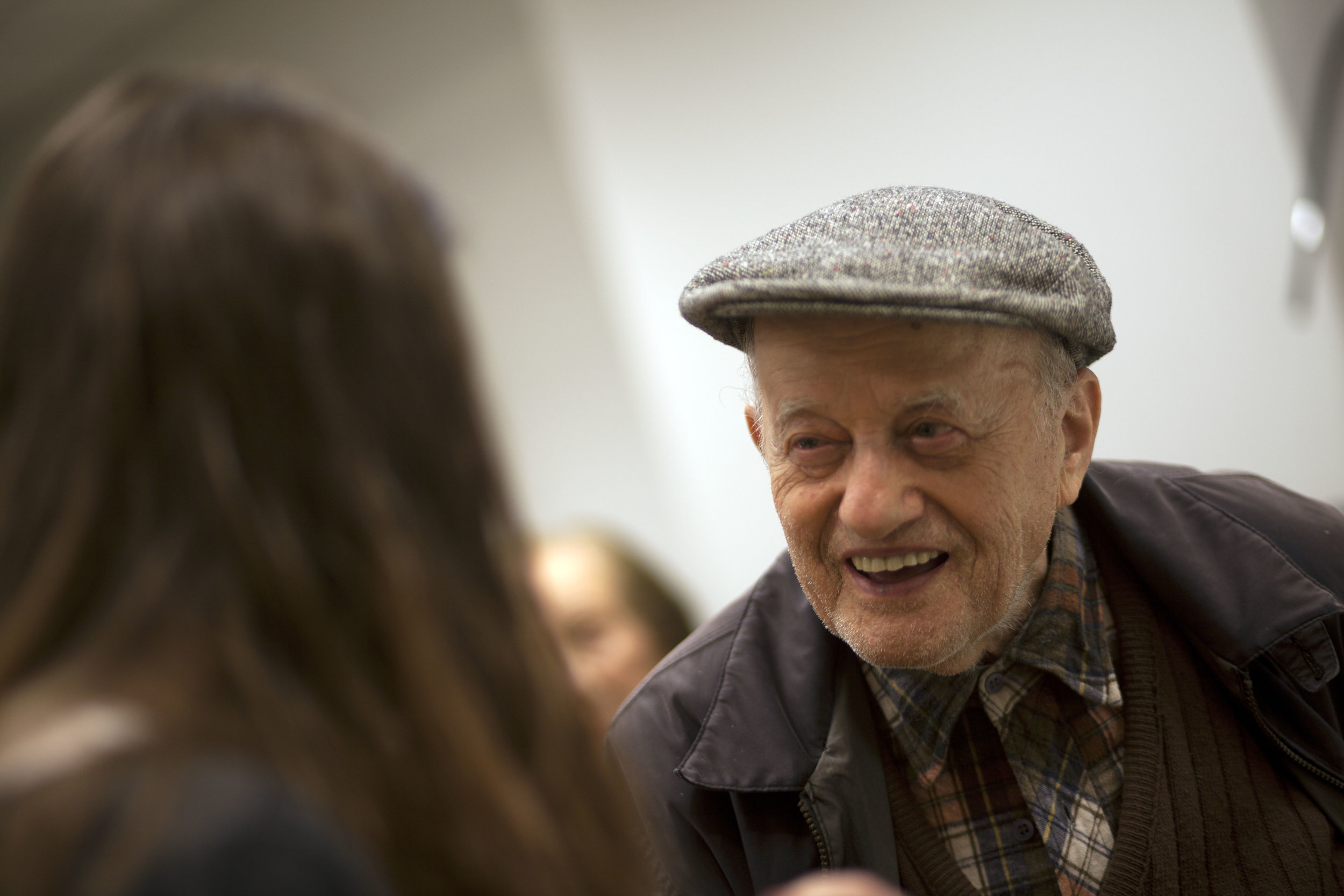 Elderly Man Talking with Young Woman .jpg