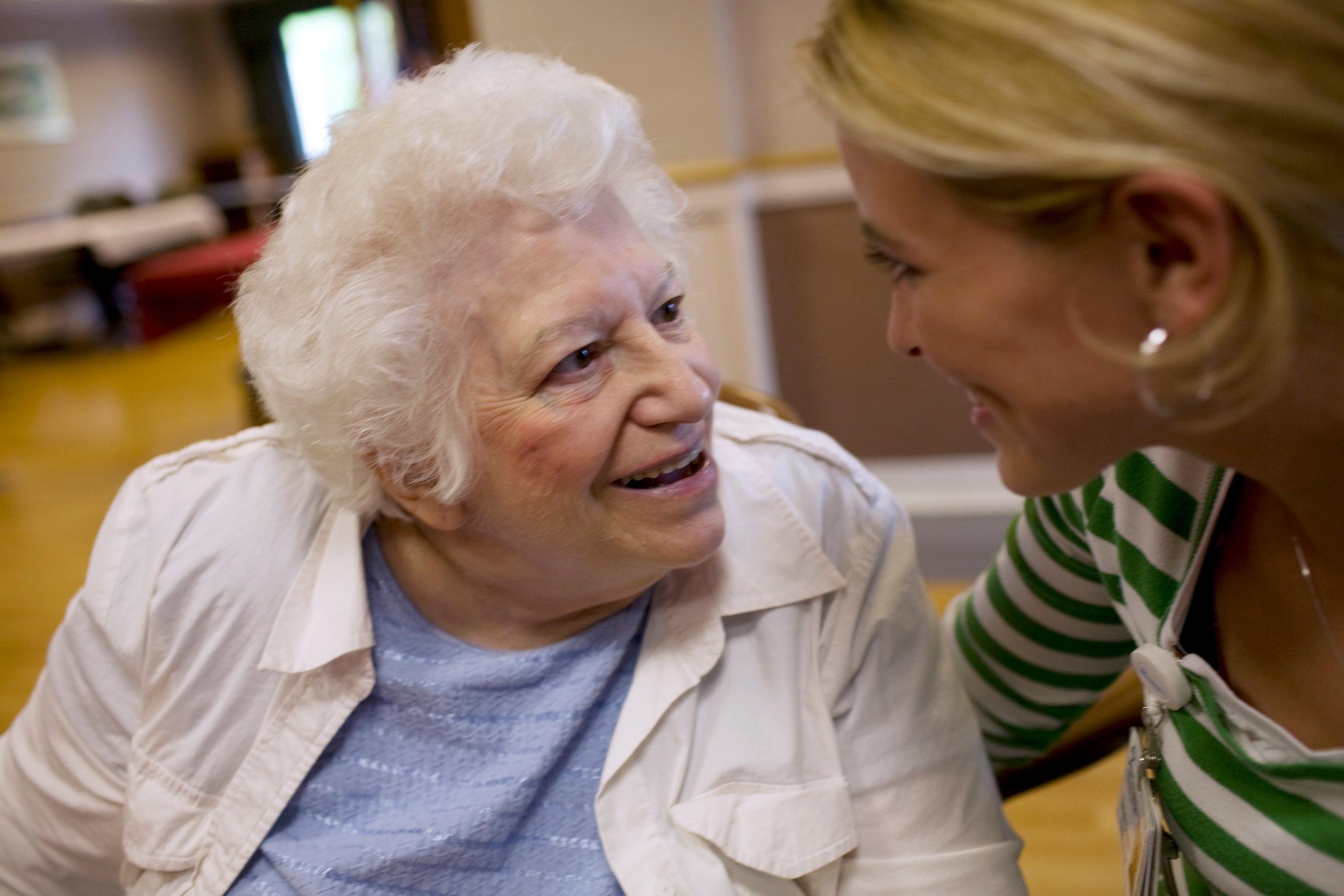 Volunteer+Talks+to+Senior+Woman.jpg