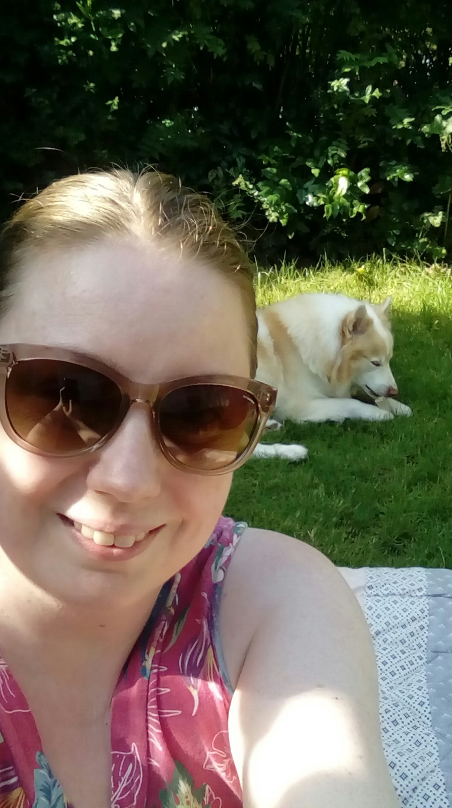 Reading in the garden… - Me and my trusted reading partner who loves when i pull out the blanket for us to sit on the grass, Bersi (seen here enjoying a chewy stick)