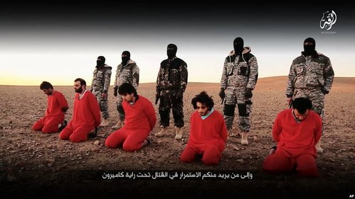 This undated image, taken from video posted online Jan. 3, 2016, by the communications arm of the Islamic State group, purports to show IS militants executing five men whom they accuse of having spied for Britain in Syria.