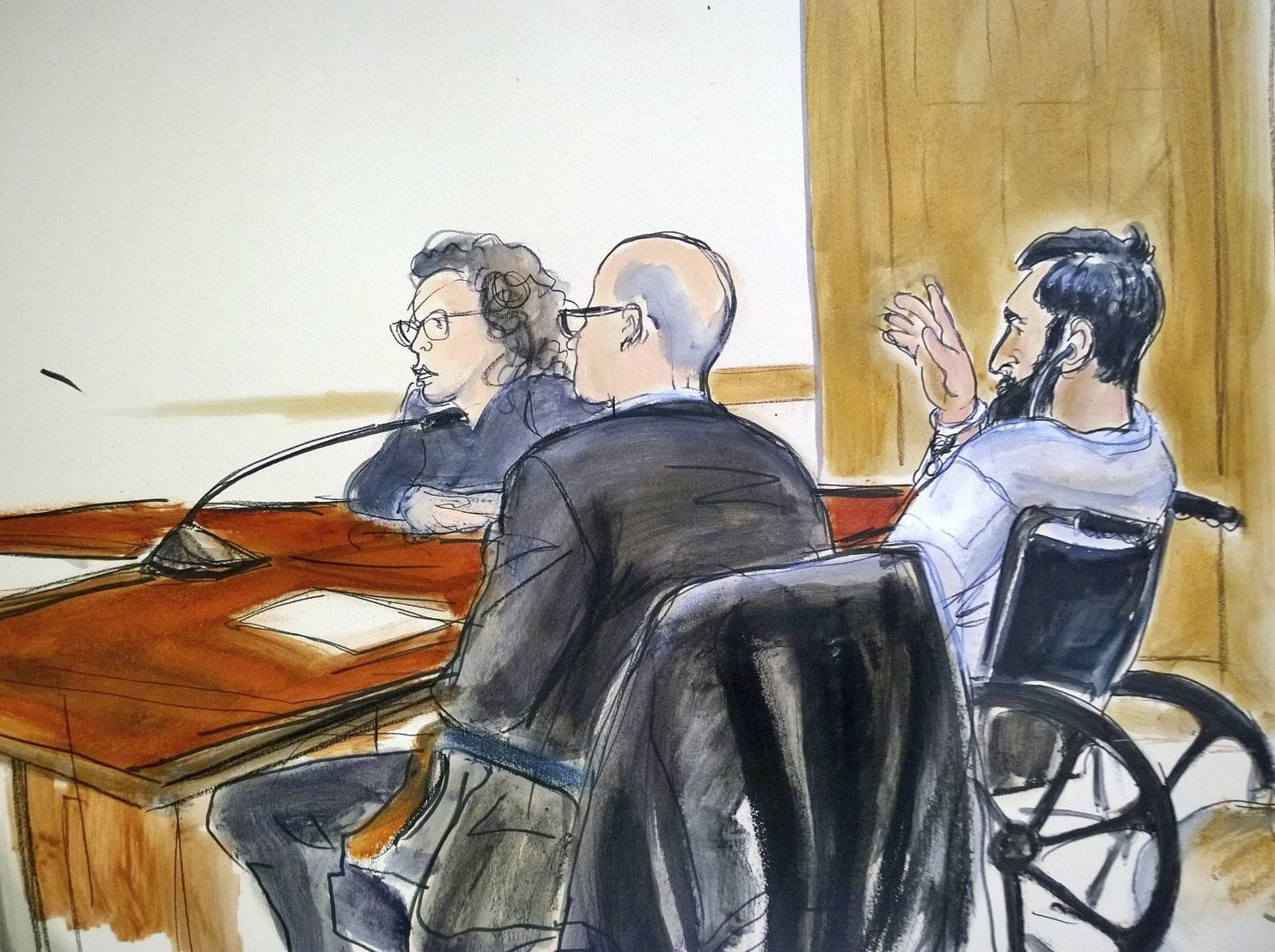 In this courtroom drawing, defendant Sayfullo Saipov, right, addresses the court during his arraignment on federal terrorism charges. The Uzbek immigrant is charged in the Oct. 31 truck rampage in New York that left eight people dead. (Elizabeth Williams/AP)