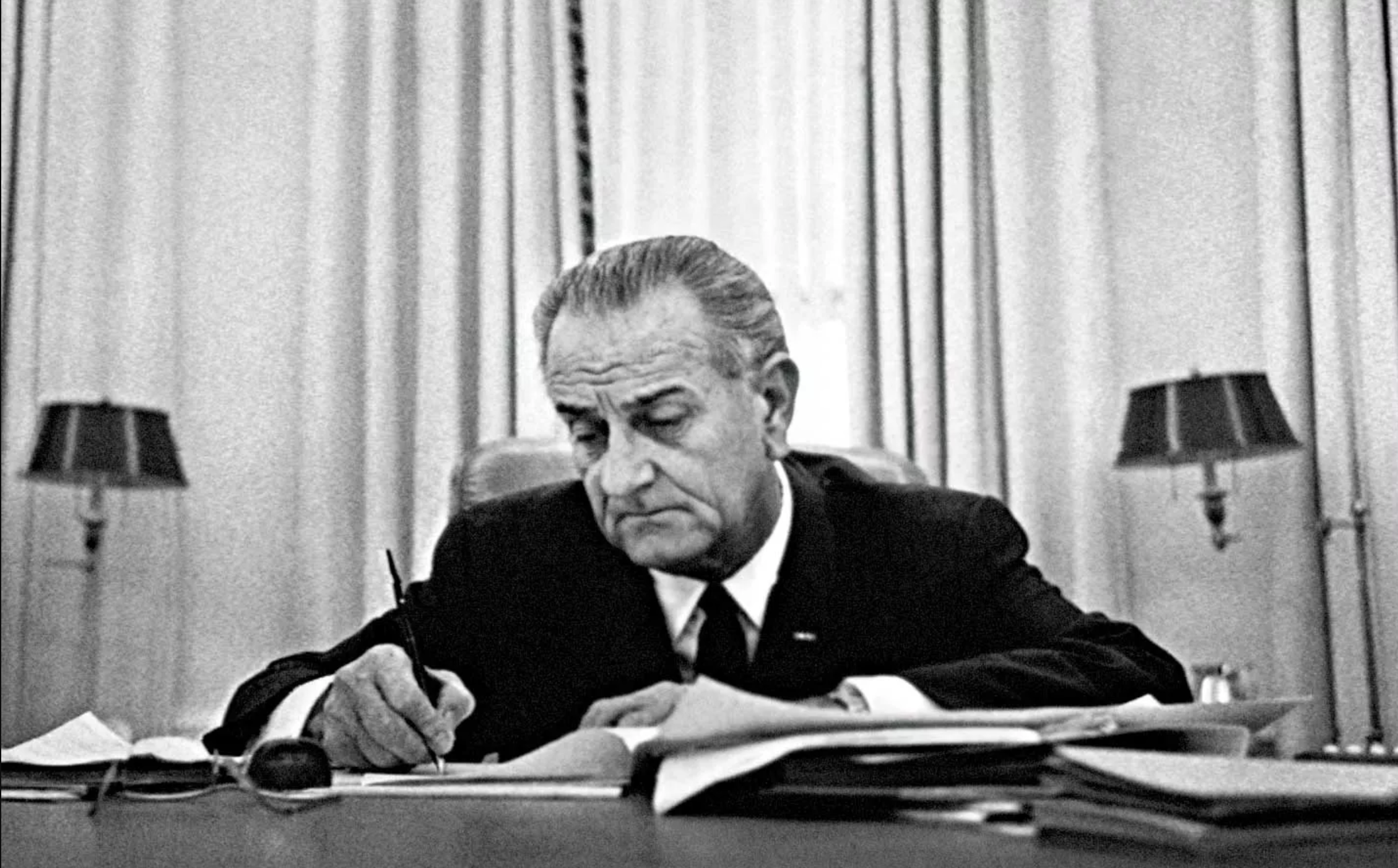 Lyndon B. Johnson signing an executive order calling Reserve Troops to active duty, 1968.