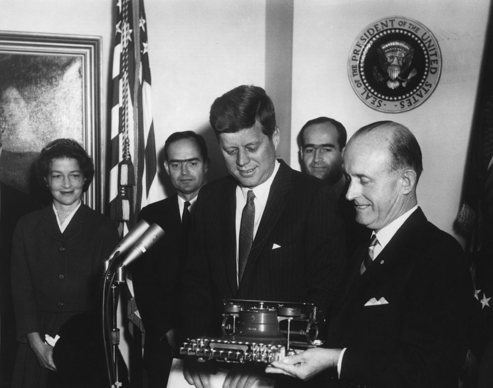 President John F. Kennedy receives one of President Woodrow Wilson's typewriters