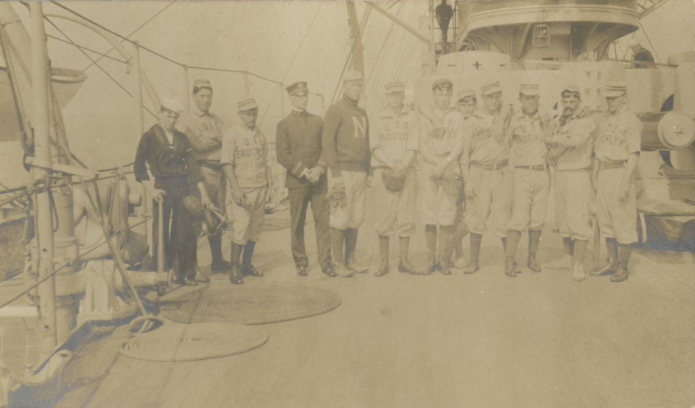 Group of Soldiers in Baseball Uniforms with Dog