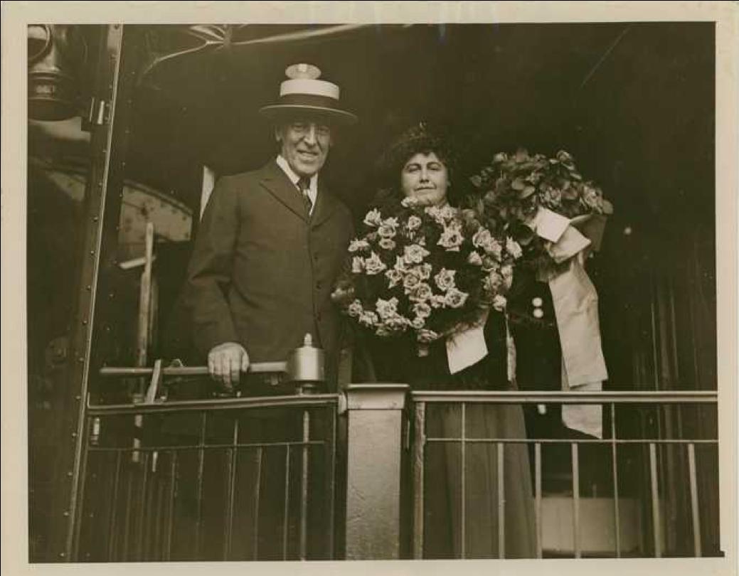 President and Mrs. Wilson Holding Roses