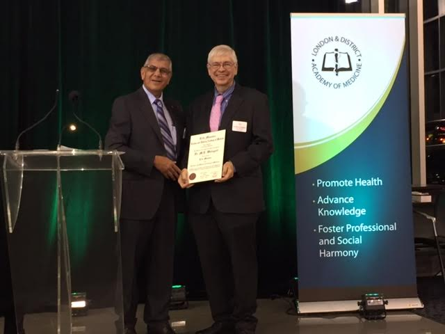 Dr. Mohamed Mithoowani presents Dr. Michael Weingert (right) with his Life Member Award at the 87th Annual General Meeting.