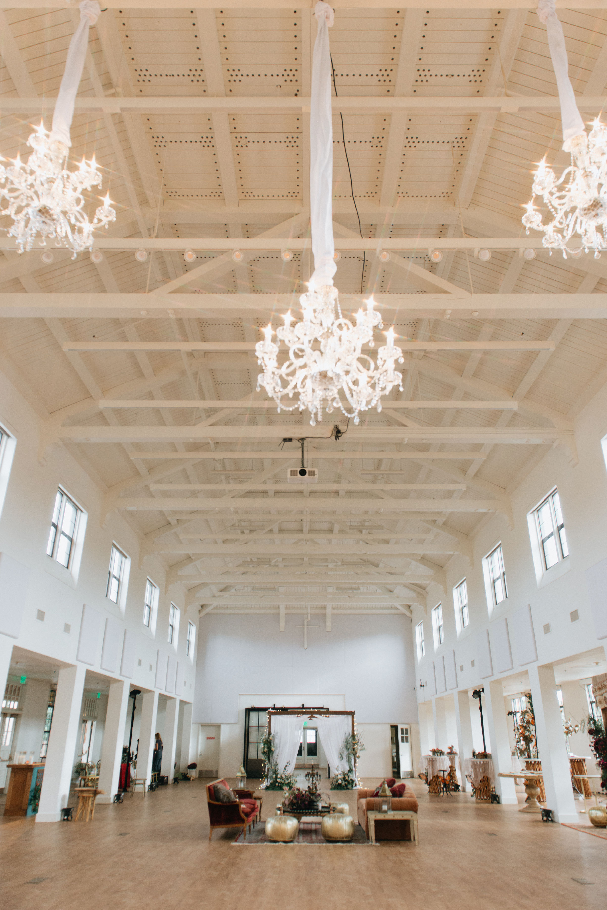 We're always obsessed with new installations and lighting hung from our grand beams and high ceilings! Great job Brilliant Event Lighting for these stunning chandeliers.