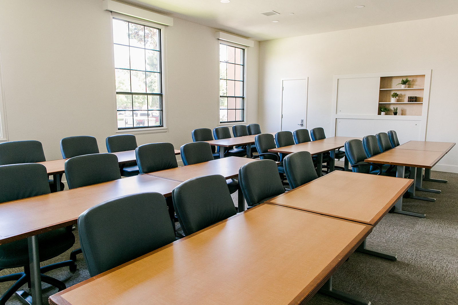 "Catalina Meeting room - Classroom style meeting room with seating for 24 guests with comfortable rolling chairs, (1) 55"" flat screen rolling TV with HDMI hookup, WiFi, and a table for coffee/food, etc. Rental is $150/hr. Please inquire for full day and non-profit rates."