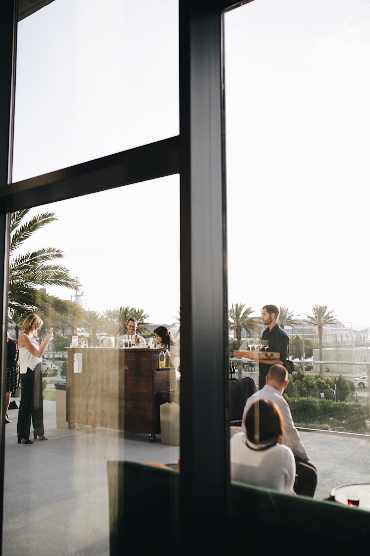 bayfront views for days - whether you're out on the terrace or inside one of the interior gathering spaces, you can see the cruise ships come in and sailboats passing by.