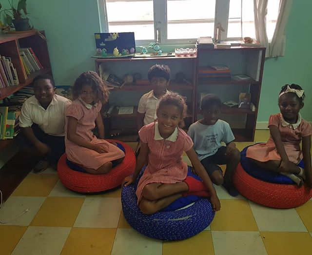 Grades 2 & 3 enjoying sitting on their recycled tyre ottomans!