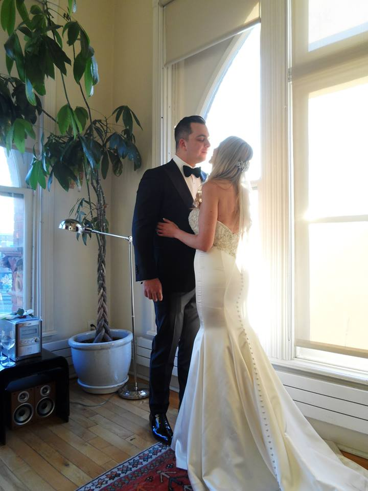 All dressed up in this stunning gown, her beau at the ready..