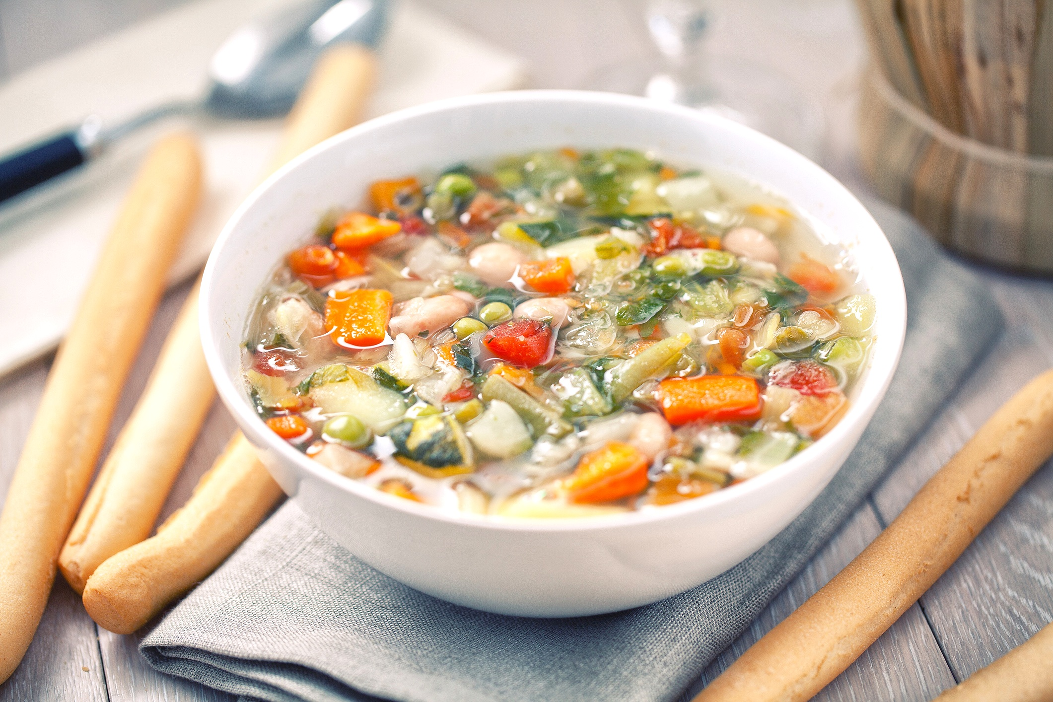 minestrone soup - a super-satisfying all-of-the-veggies bowl. We make ours with banza pasta, and white beans.Serves: 61 tablespoon olive oil, plus more to serve1 small onion, finely chopped2 medium carrots, finely chopped2 medium celery stalks, finely chopped2 medium cloves garlic, peeled and smashedKosher salt and ground black pepper¼ teaspoon crushed red pepper flakes2 bay leaves1 jar 16 oz not just pasta sauce1 ½ quart chicken stock (or water if vegetarian)1 parmesan rind, plus shaved parmesan to serve1 cup chopped green beans (½ inch pieces)1 cup eat banza macaroni1 15 oz can cannellini beans, rinsed and drained1 cup frozen peas2 cups baby spinach1 tablespoon red wine vinegar, plus more to tasteTorn basil, to serve1. In a large heavy bottomed pot or dutch oven, heat the oil over medium heat until shimmering.2. Add the onion, carrots, celery, garlic, ½ teaspoon salt, ¼ teaspoon black pepper, ¼ teaspoon red pepper flakes, and 2 bay leaves, cook until softened, about 7-10 minutes.3. Stir in not just pasta sauce, scraping up any brown bits at the bottom of the pot, chicken stock, and parm rind, bring to a boil.4. Add the green beans, pasta, and 1 teaspoon of salt and cook, maintaining a steady simmer, until the beans are tender and the pasta is al dente, 8-10 minutes, adding the cannellini beans and peas halfway through.5. Stir in the spinach until wilted and add the red wine vinegar.6. Season to taste and garnish with freshly torn basil, grated parmesan, and drizzle with olive oil.