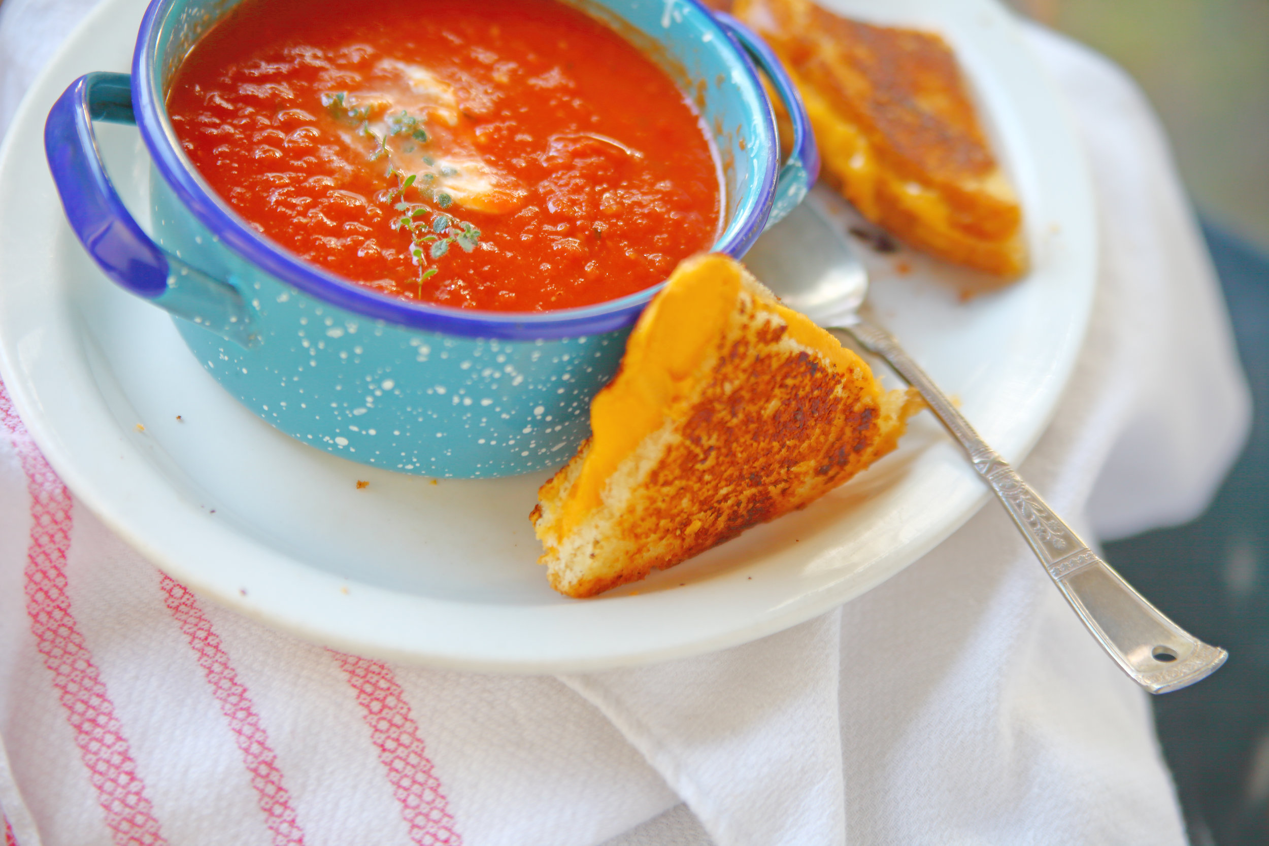 mini grilled cheese bites with not just pasta sauce. - a snackable riff on the classic grilled cheese and tomato soupServes: 4No need to add butter to the pan before cooking the grilled cheeses, the teaspoon of mayo on each slice of bread allows the bread to brown slowly and evenly.1 16 oz jar not just pasta sauce4 slices of sourdough bread4 teaspoons mayo, divided1.5 oz sharp white cheddar cheese (about 3 slices)1.5 oz provolone cheese (about 3 slices)olive oil, for servingMaldon salt, for serving1. add the not just pasta sauce to a blender and puree until smooth, about 30 seconds.2. reserve two tablespoons and set aside. pour the remaining sauce into a small sauce-pan and heat over low until beginning to simmer, about 10 minutes.3. meanwhile, place all four pieces of bread on a cutting board and slather with 1 teaspoon of mayo each (this is key to even browning). Flip two over and spread with the reserved tomato puree.4. in a 12-inch nonstick skillet over medium heat, place 2 slices of bread, mayo side down, and add three slices of mixed cheese to each. top with the remaining slices of bread, puree side down, and cook until the bottom side is golden brown, about 6-8 minutes. carefully flip the sandwich and cook for another 3-5 minutes, lightly pressing down on the sandwich occasionally to ensure even browning.5. transfer the sandwiches to a cutting board and cut each into 6 even triangles, place on a platter and sprinkle with Maldon salt. pour the tomato puree into small bowl for dipping and drizzle with olive oil.