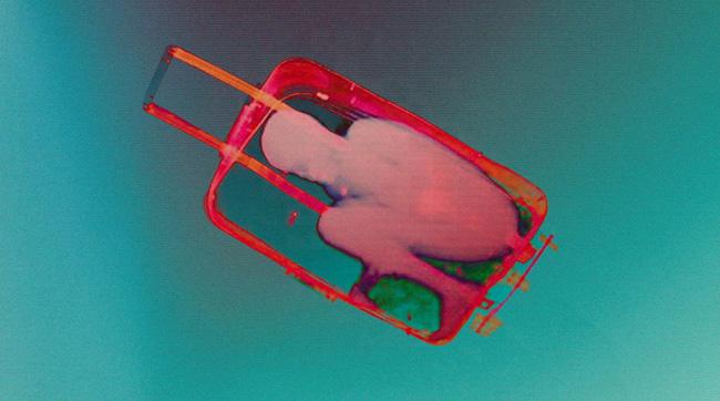 Julio César Morales,  Boy in suitcase , 2015, HD Video, 3:33 minutes