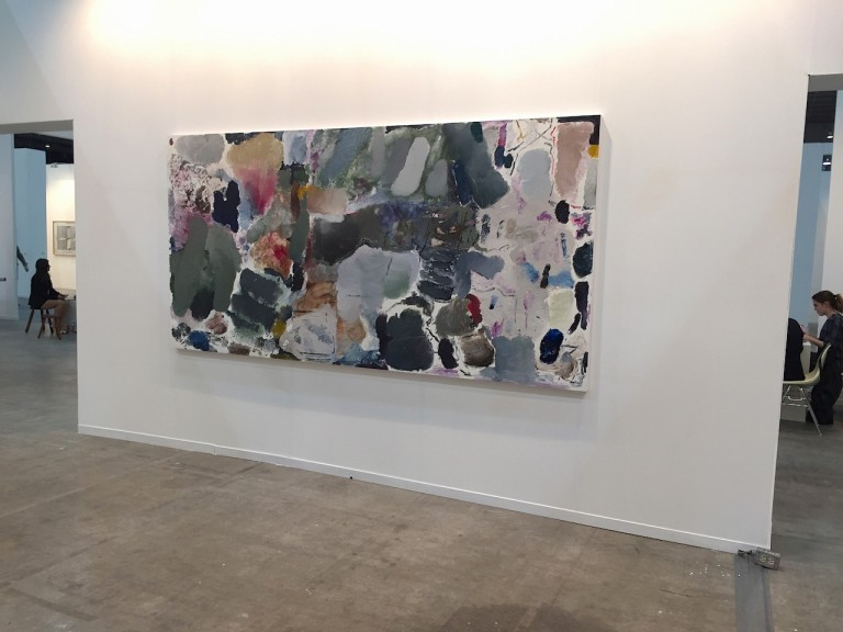 """Across the aisle, another artist who paints with his hands —albeit with very different results — was showing in  Steve Turner 's booth. Argentine artist Joaquín Boz's abstract canvases feature a rhythmic assortment of blobs, strokes, scrapes, and swipes, reflecting Kandinsky's musicality with the physicality of Guston's paint handling. Boz is constantly listening to music while painting, channeling the aural inspiration onto the canvas. """"Music is a big part of his working method,"""" said Turner, """"and I think the curators viewed it as a performative effort."""""""