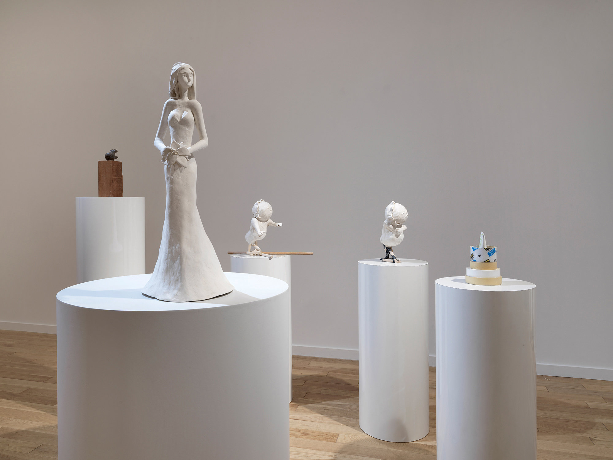 """Sam Anderson's installation at Chapter NY, from left: """"The King"""" (2016-18), wood and ceramic; """"Paula"""" (2018), papier-mâché wood and metal; """"Two Babies"""" (2018), papier-mâché, wood, glue and electric tape; and """"Sunrise"""" (2018), tape rolls, acrylic and sunscreen.CreditDario Lasagni, via Chapter NY"""