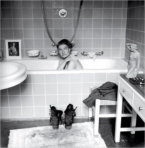 Miller in Hitler's bathtub (1945). Image via Messynesschic.
