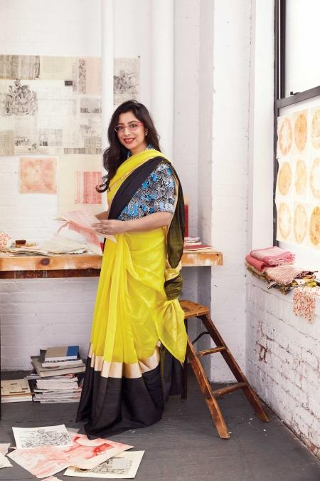 NANDINI CHIRIMAR.  Cotton shirt,    Michael       Kors Collection.    Silk sari,    Raw Mango.    Acetate glasses, metal ring; both Chirimar's own
