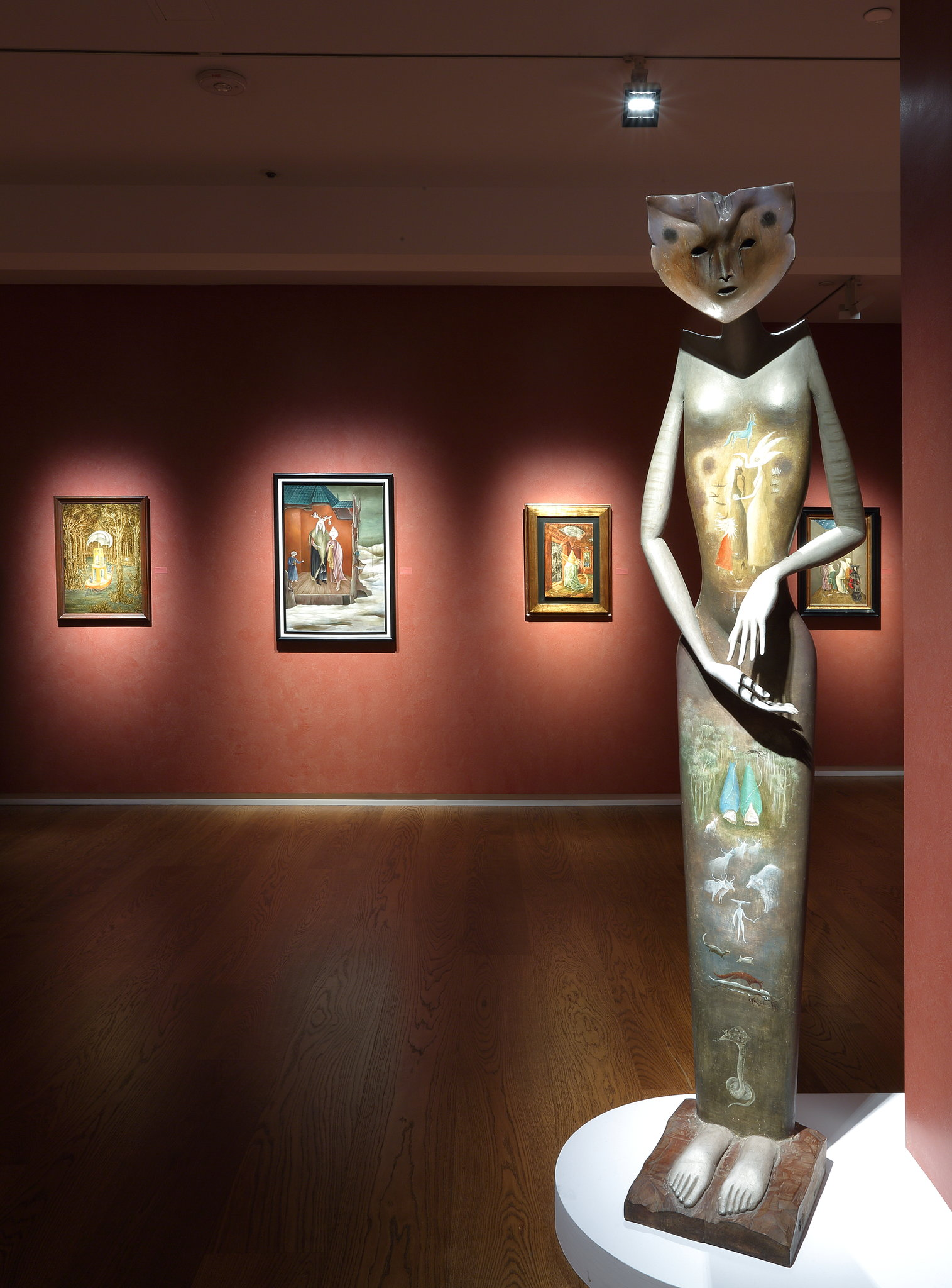 "An installation view of ""Surrealism in Mexico"" at Di Donna Galleries. Foreground, Leonora Carrington's painted sculpture, ""La Grande Dame,"" 1951. Background, a mixture of works by Varo and Carrington.  2019 Leonora Carrington/Artists Rights Society (ARS), New York; via Di Donna Galleries"