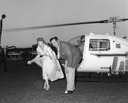 LUCILLE BALL AND DESI ARNAZ AT THE THUNDERBIRD COUNTRY CLUB