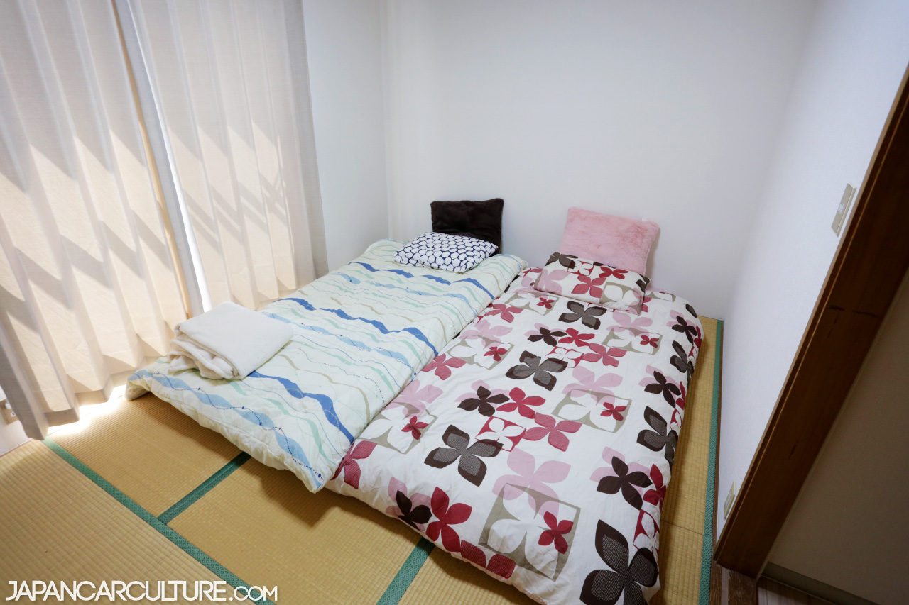 Two futon beds in a traditional tatami bedroom.