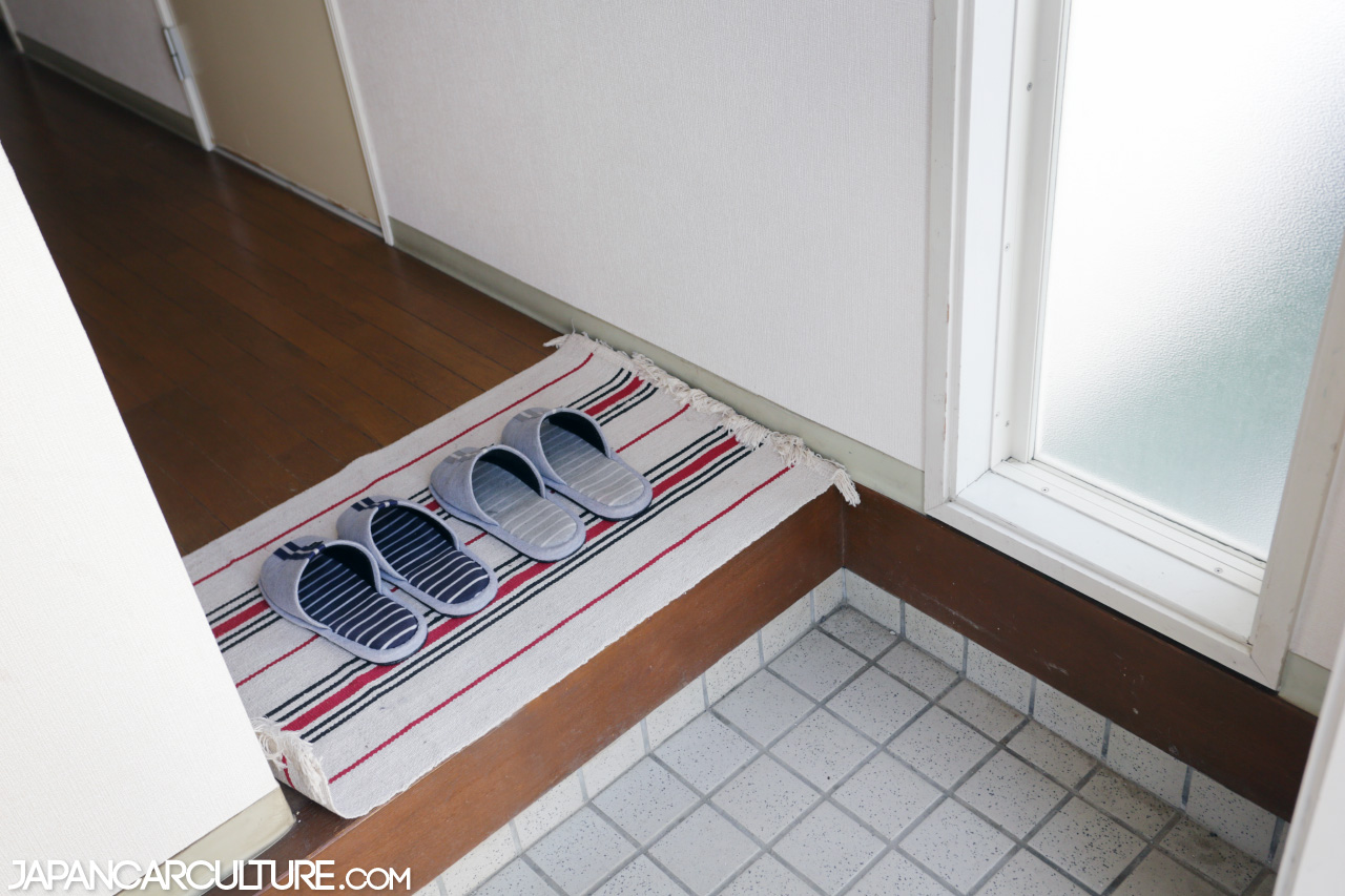 Entrance of a Japanese townhouse. Here you can see the  genkan,  the area where you remove your shoes.