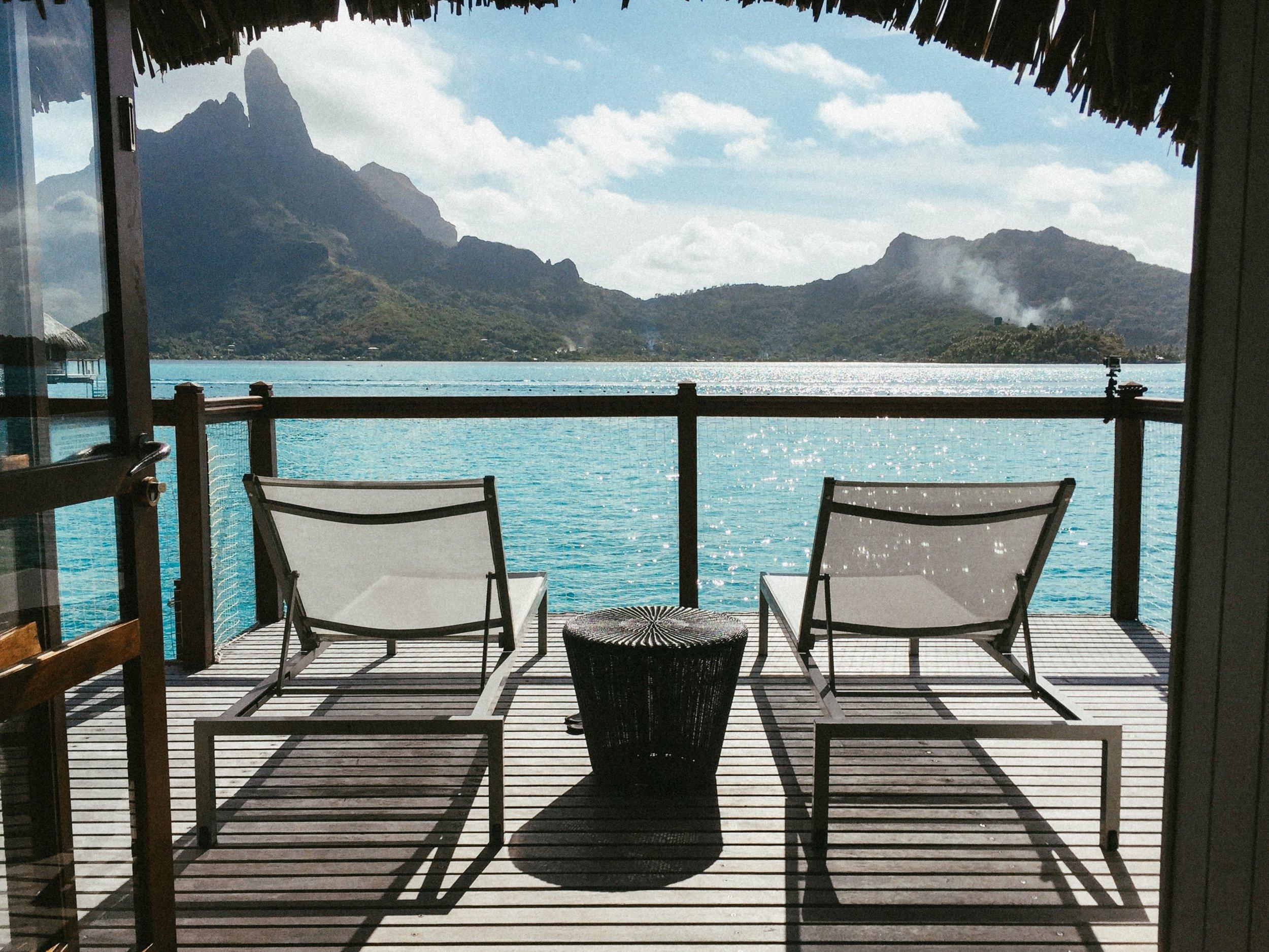 Two lounge chairs on patio in Bora Bora