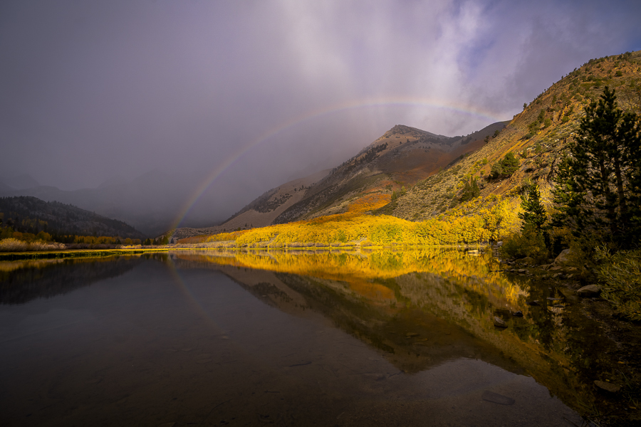 Sierra Nevada Lake sunrise reflection with a rainbow  This was the third time we had shot at this lake in 24 hours, and as you can see, we were Kindly rewarded for it.