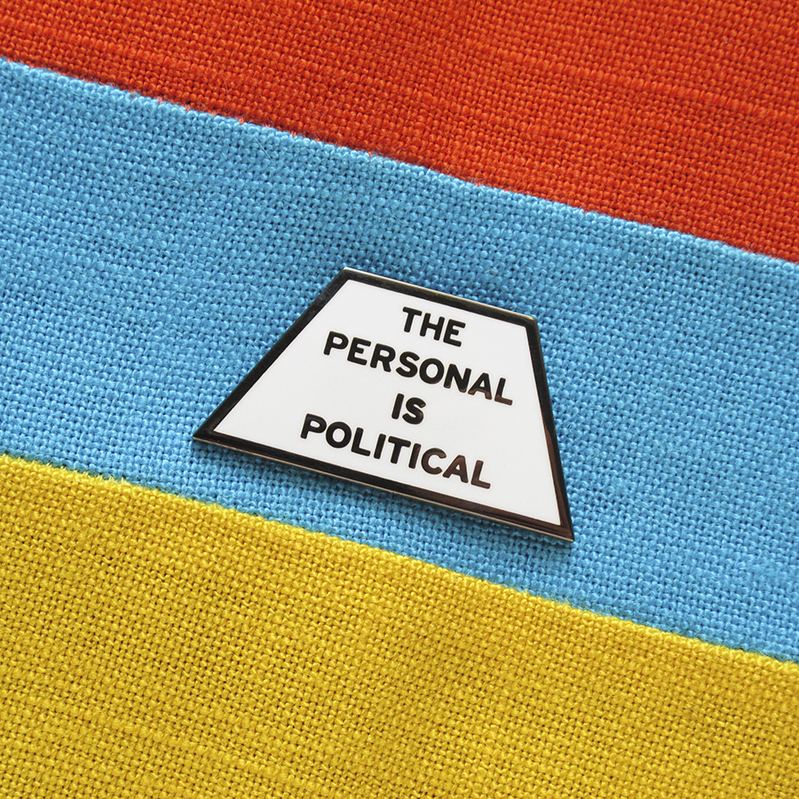 """The Personal is Political"" enamel pin,  $12"