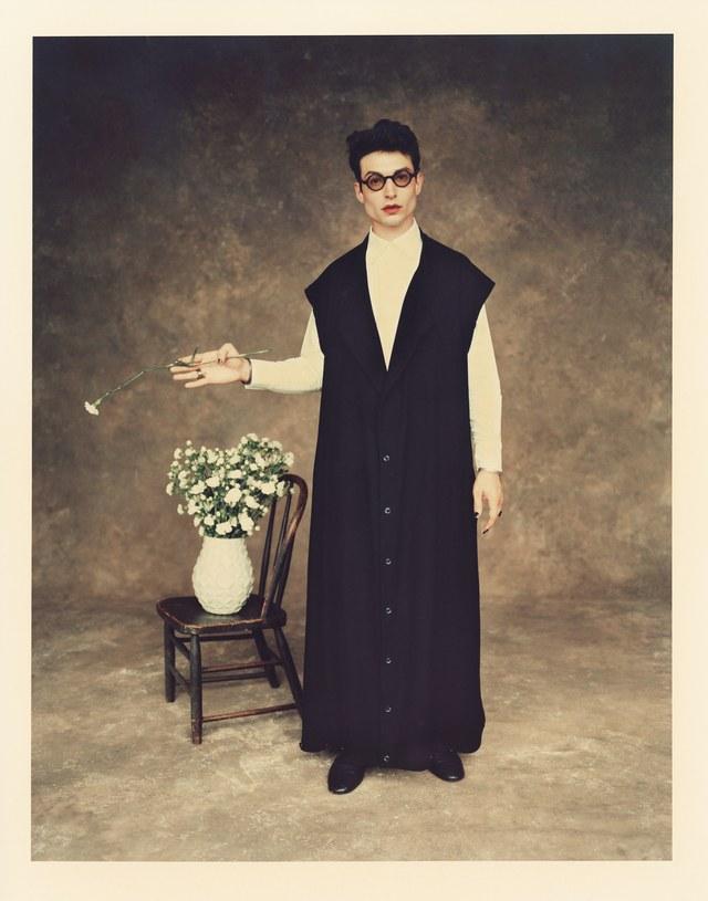 Glasses: Moscot ($280); coat: Yohji Yamamoto ($2,100); shirt: Pyer Moss ($520); left-hand ring: John Hardy ($795); shoes: Giuseppe Zanotti ($895)