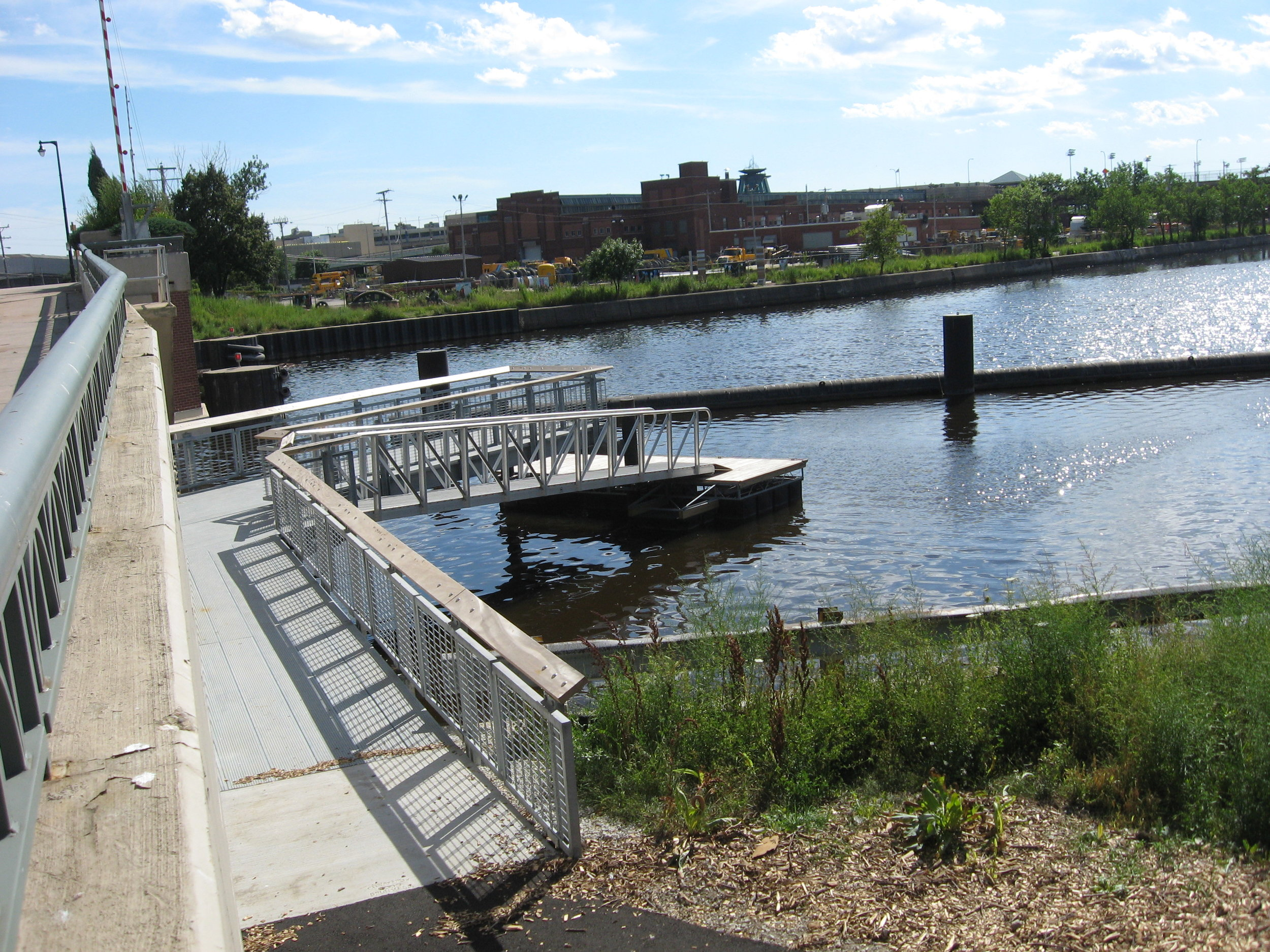 Emmber Lane    Paddler-friendly access (pier with retrofit)  Parking: On-street and in Keep Greater Milwaukee Beautiful lot