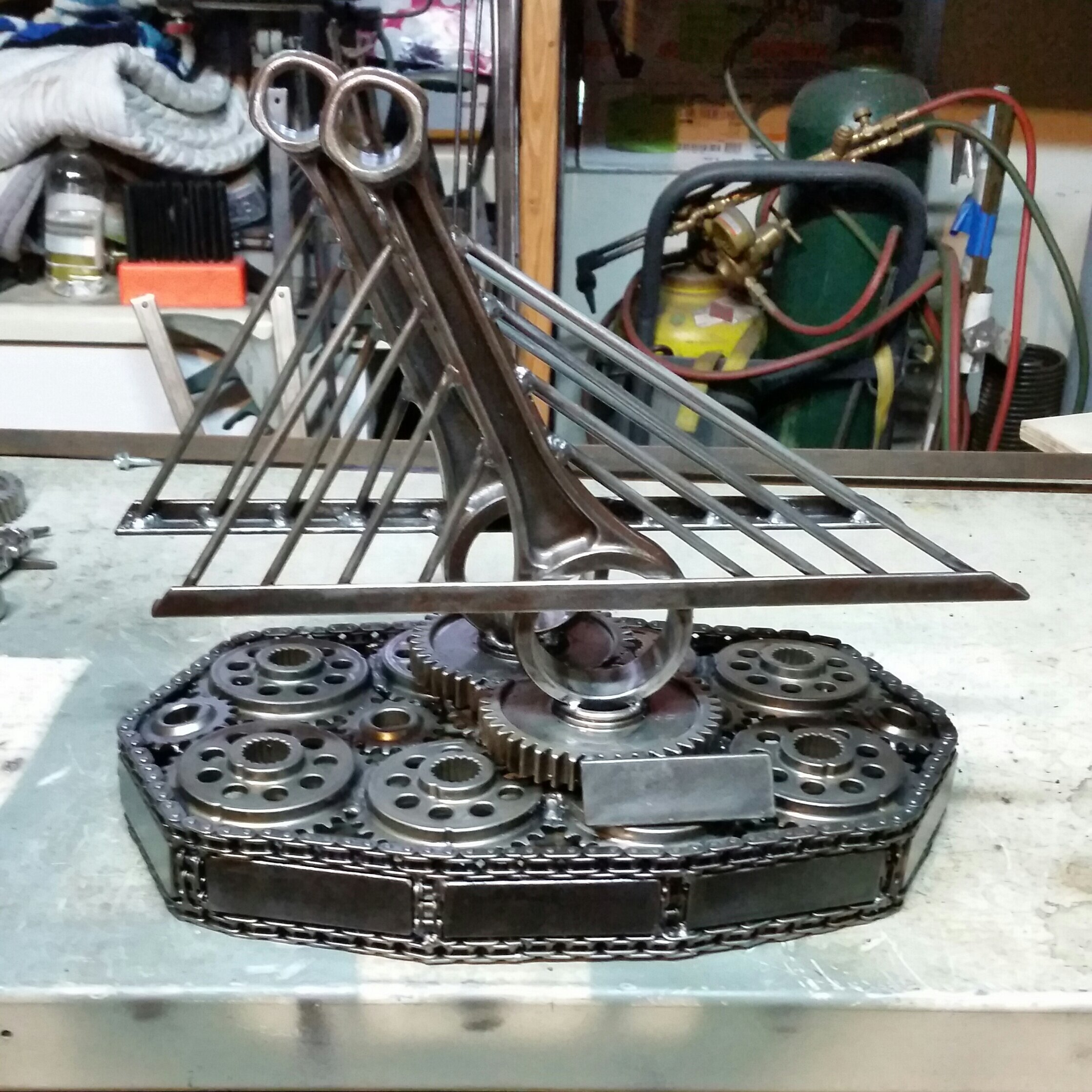 Adam Buth, a local artist, creates custom sculptures, mementos, and trophies from motorcycle parts.