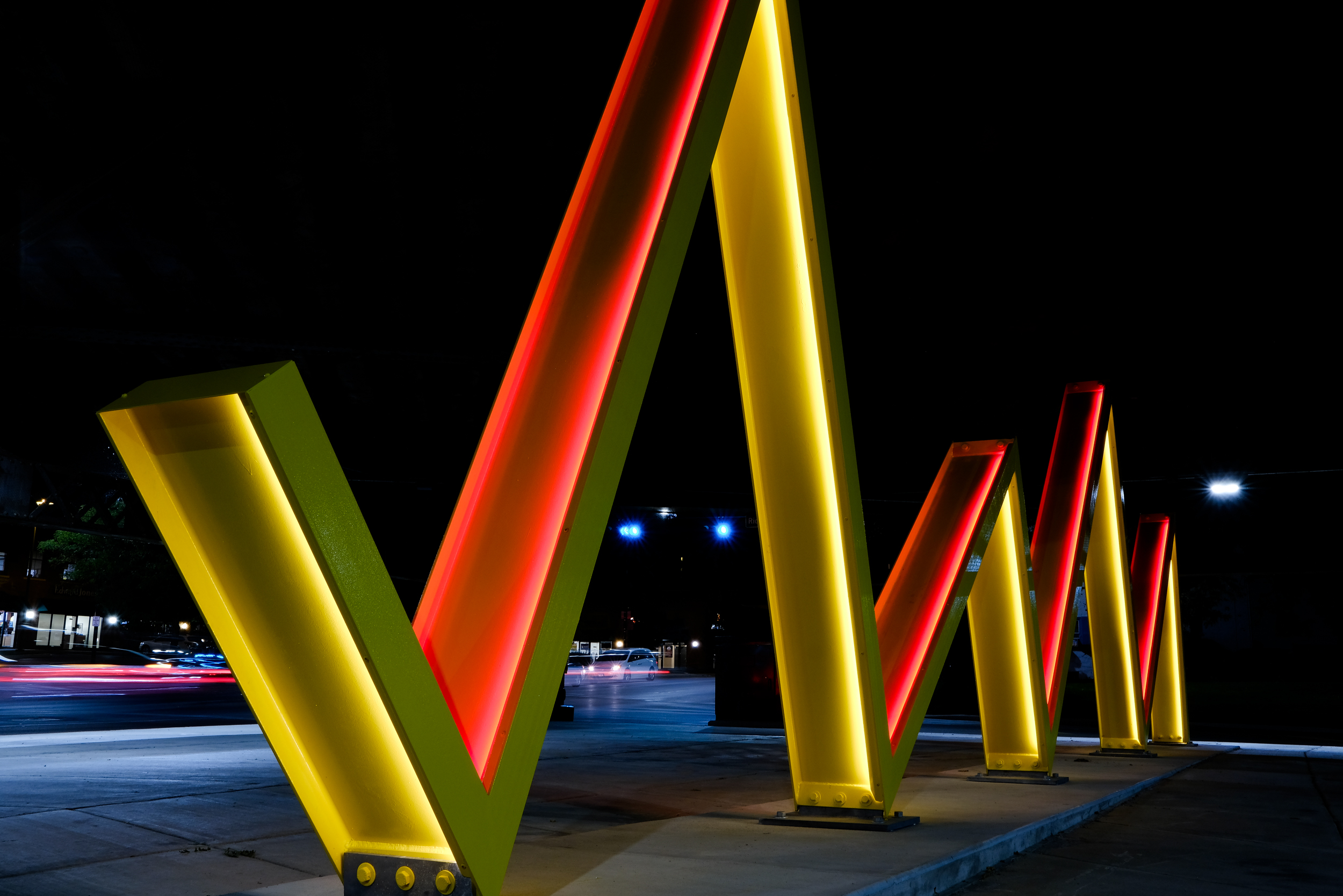 """Warren Langley - """"Stitch"""", the title of the work, is a 24 hour (day and night) at the intersection of Green Bay Road and Emerson Street.See how this sculpture transform the streetscape →"""