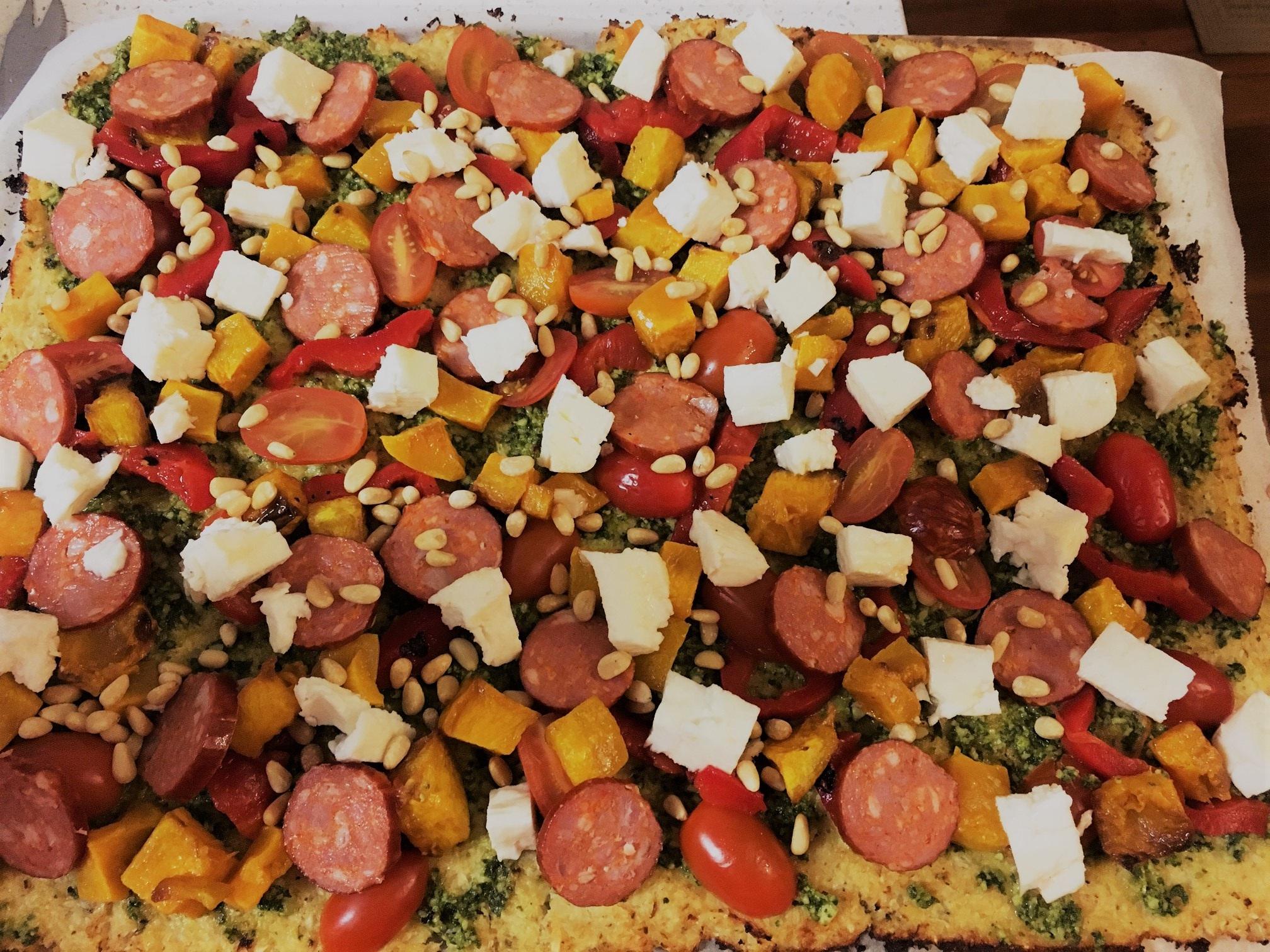 My Friday night pizza with homemade pesto, roast pumpkin, tomato, roast capsicum, chorizo, pine nuts and haloumi.