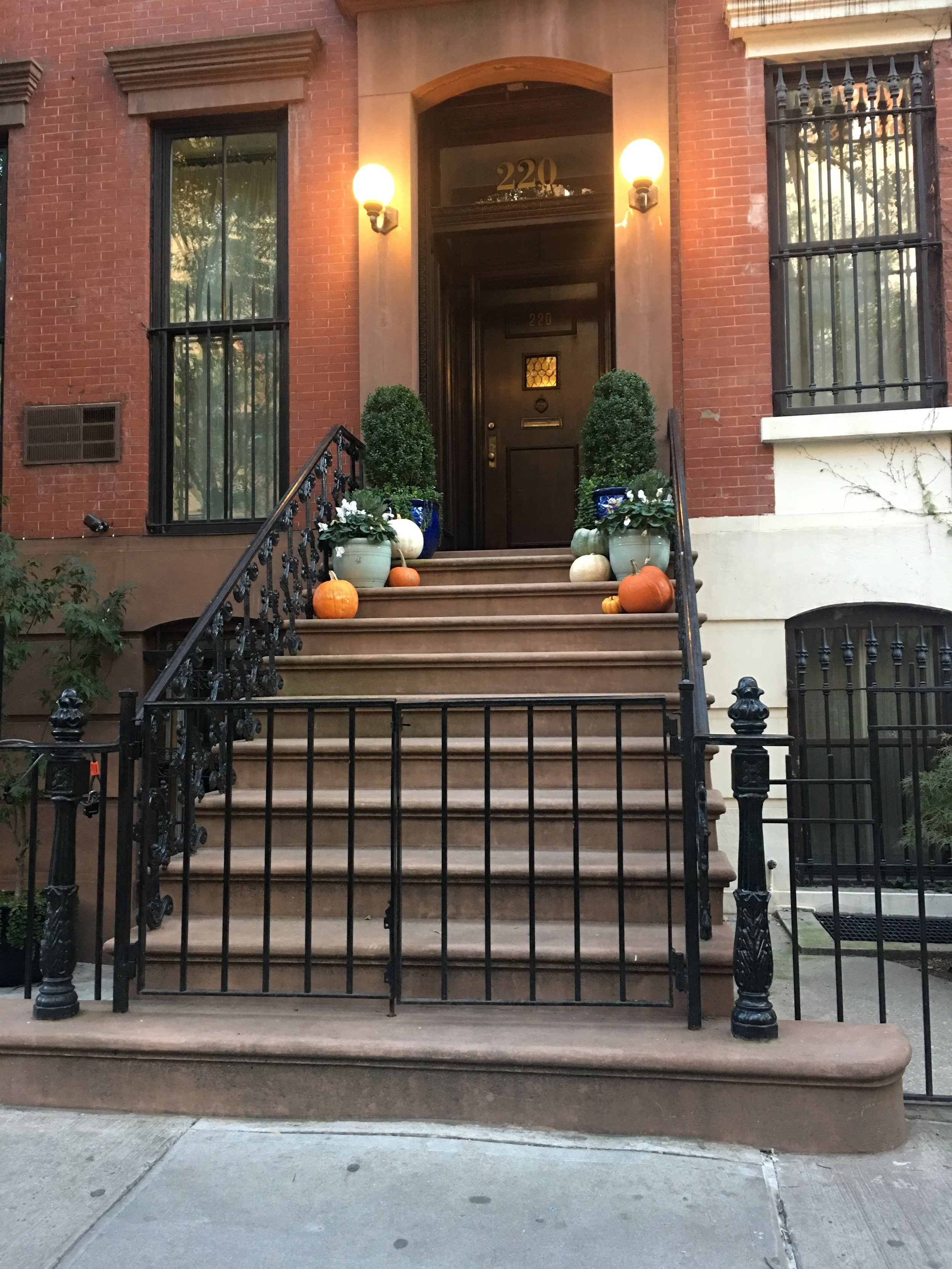 Brownstone house with pumpkins.jpg