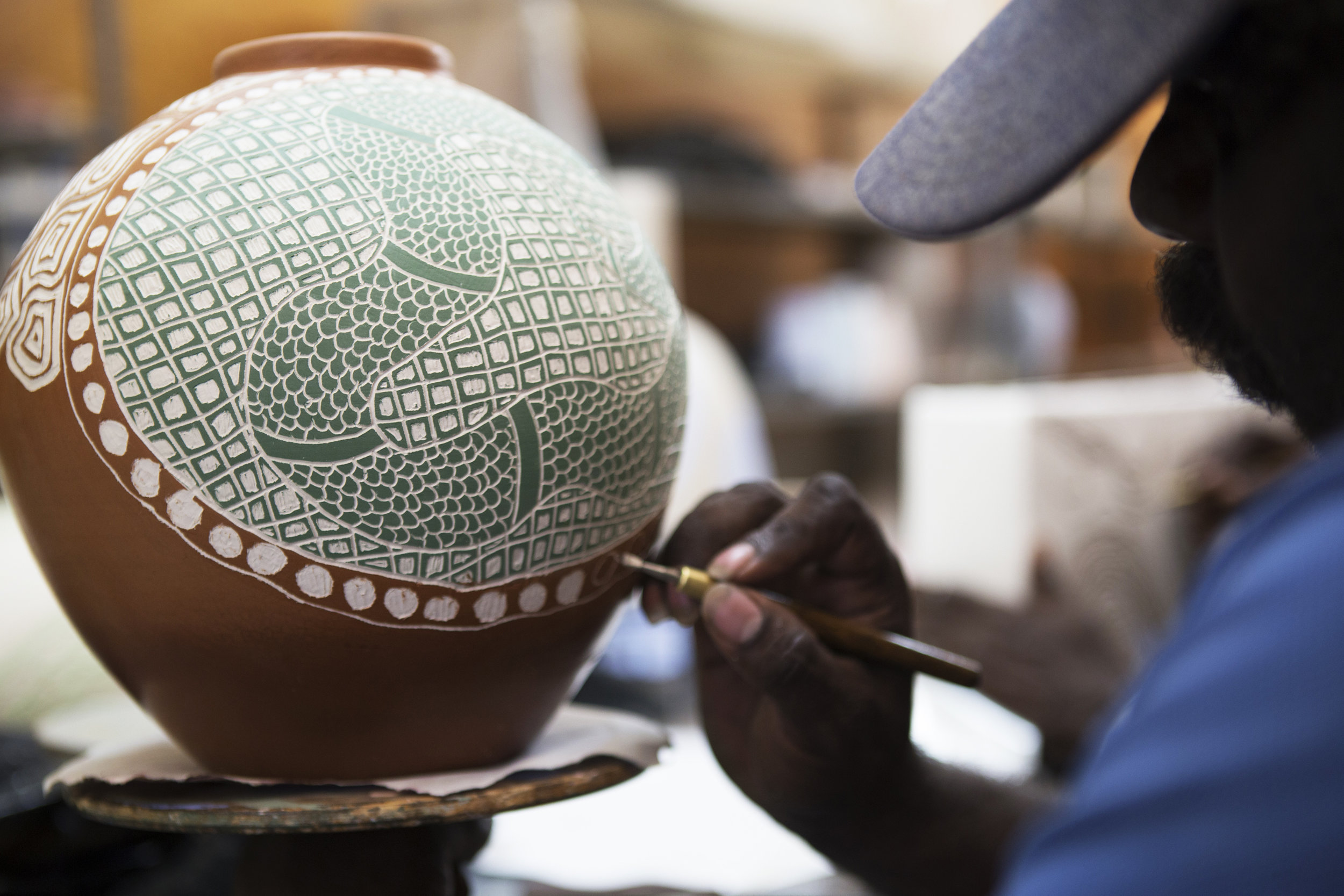 Sabbia Gallery - Clay Stories - Derek Jungarrayi Thompson at Ernabella Ceramics studio.jpg