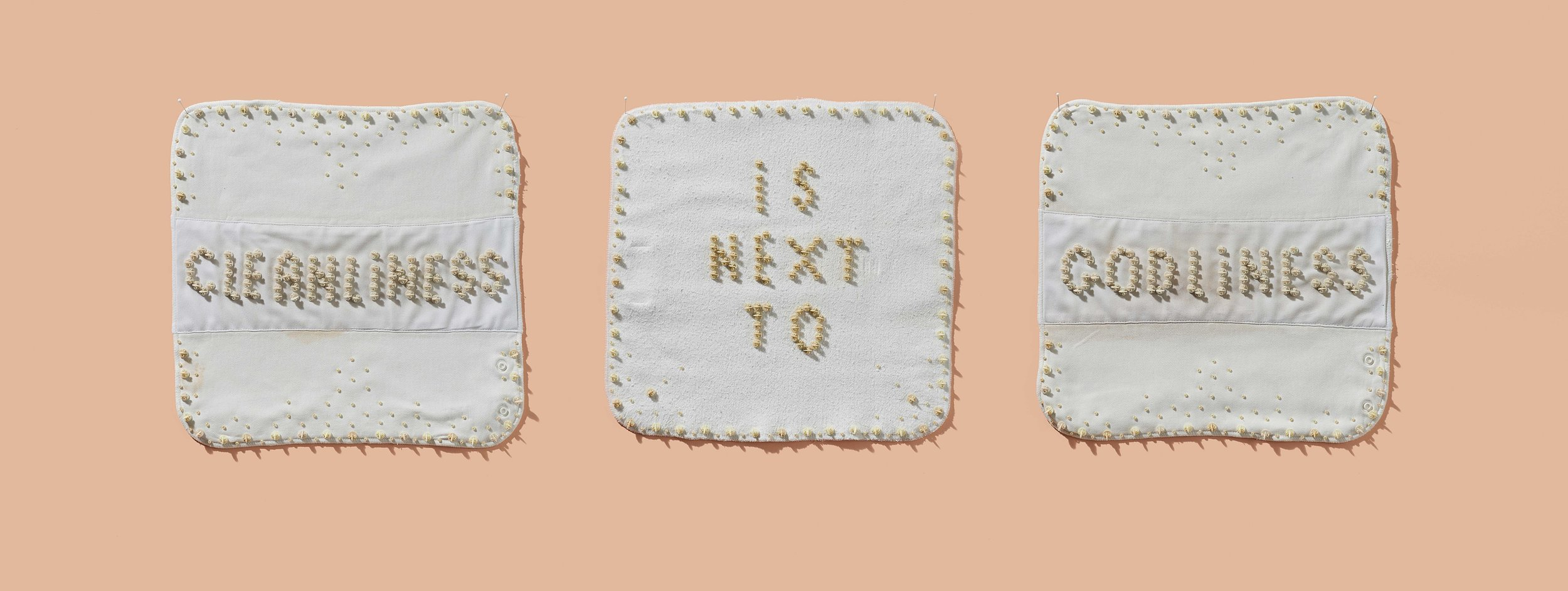 Deborah Prior,  Domestic White Work,  2019 ,  nappy liners, Squatter sheep tokens, beads ,  3 panels each approx. 320 x 320 mm. Photo: Sam Roberts.