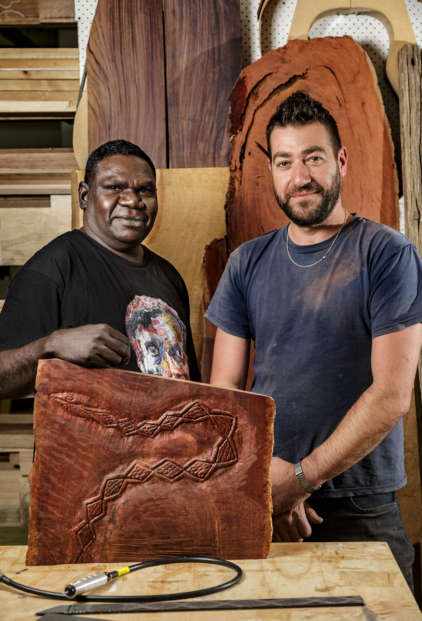 Gunybi Ganambarr and Stephen Anthony, with Gunybi's test carving in River Red Gum.  Photo courtesy Saul Steed, AGSA