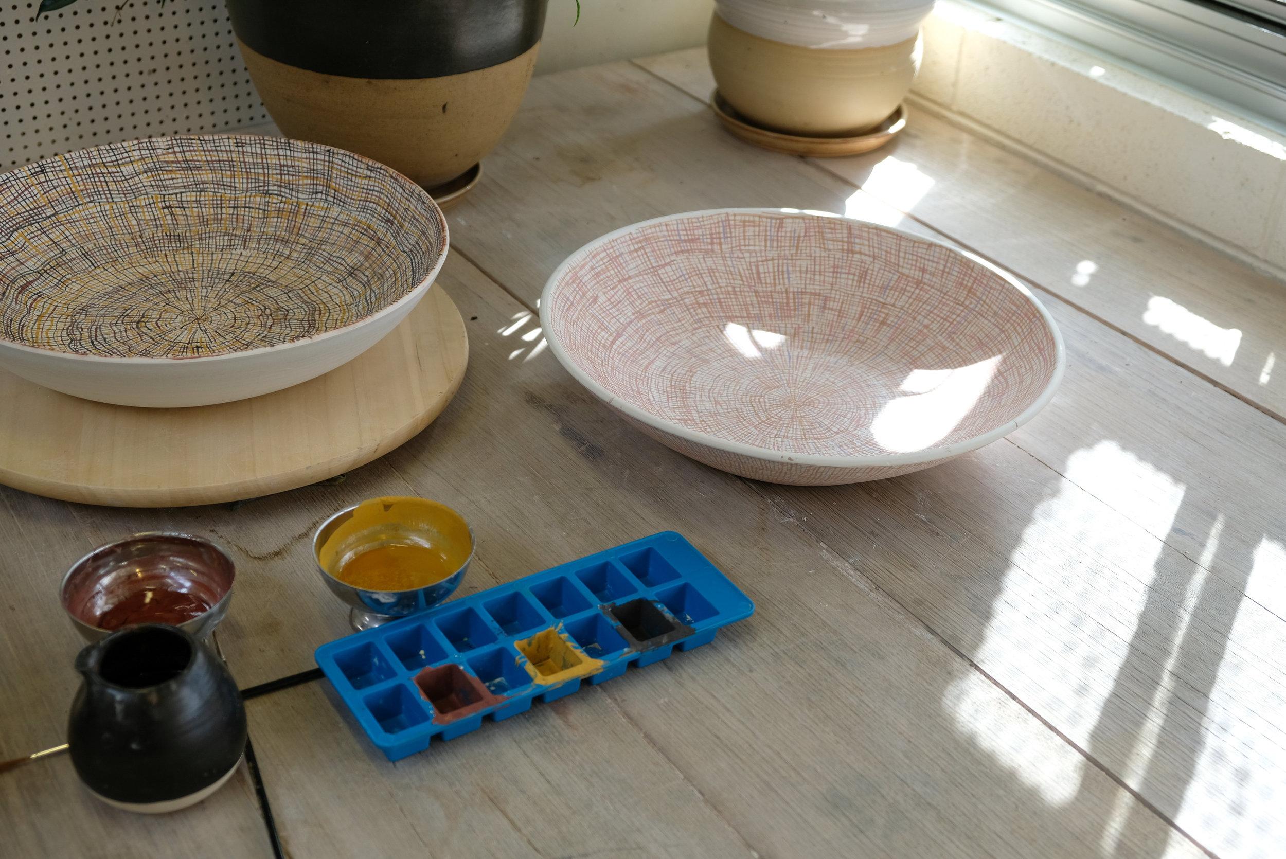 Translating weavings with ochre paint onto ceramic forms. Photo courtesy JamFactory