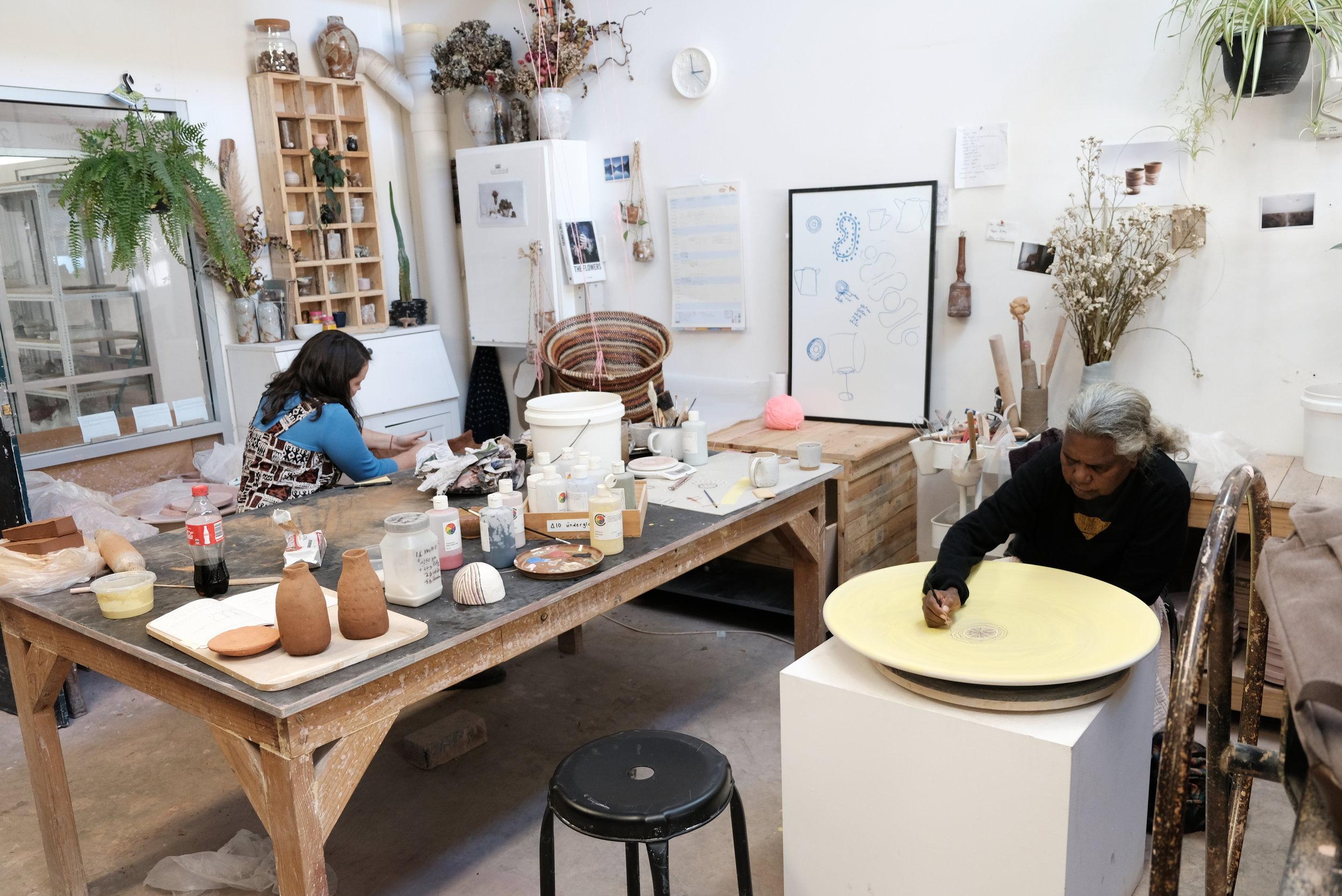 Regina and Ashlee at work in Ashlee's studio. Photo courtesy JamFactory.