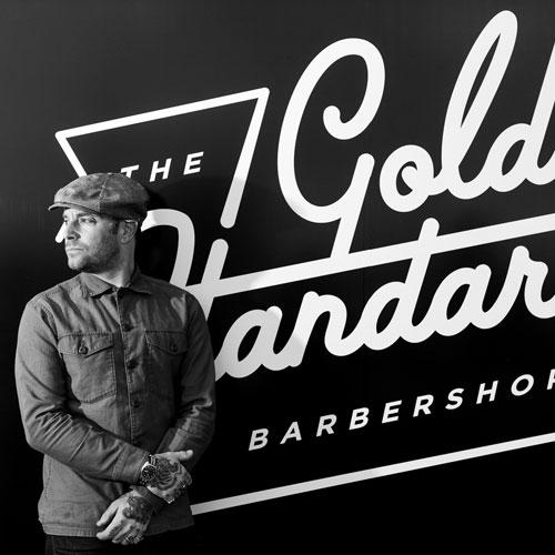 the-gold-standard-barbershop-richard-front-store.jpg