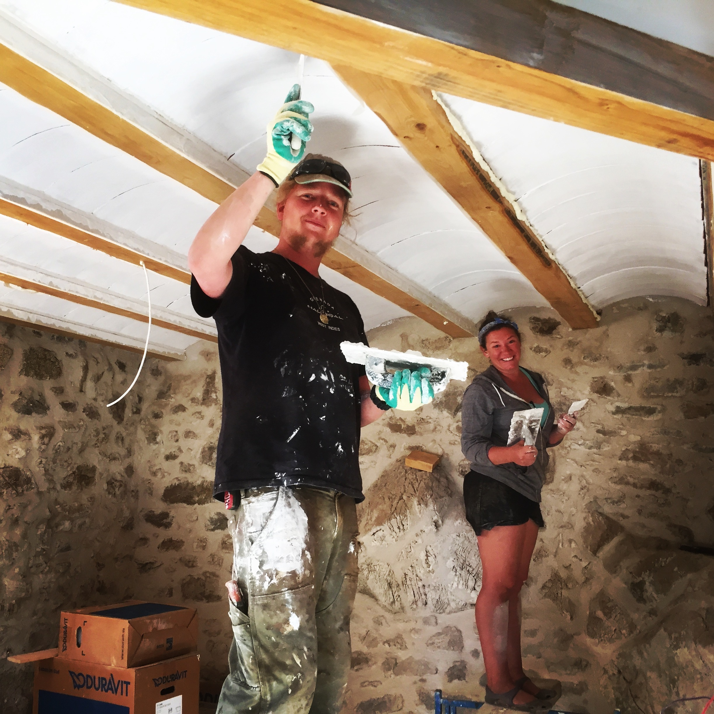 Luka and Dani painting the ceiling after fitting the capping beams
