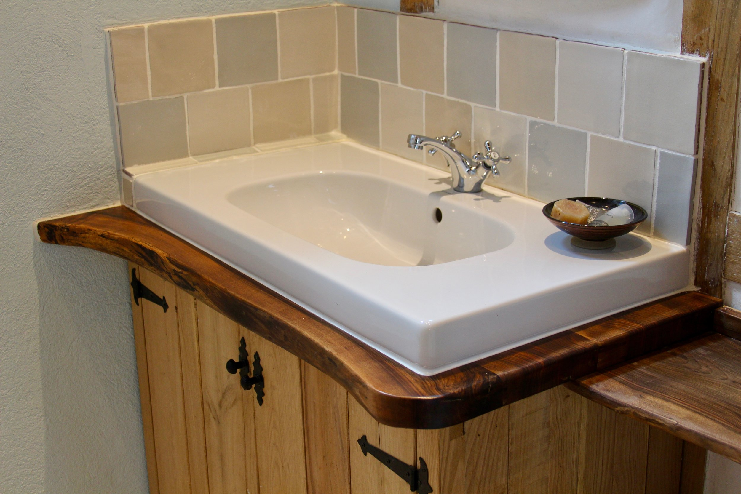 Rustic walnut washbasin surrouns