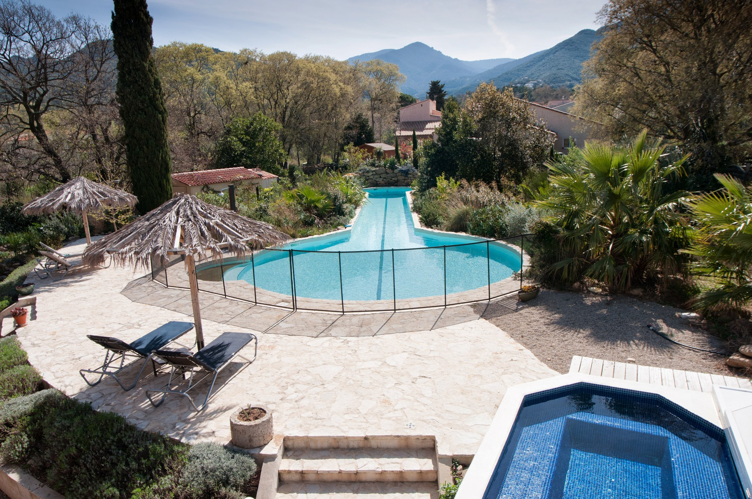 Pool, hot tub and sun loungers; view of the Alberes mountains beyond