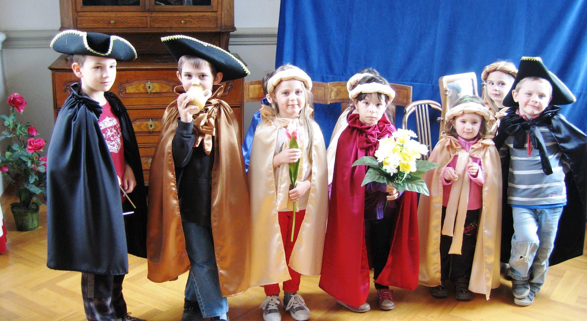 Children dressed in period costumes