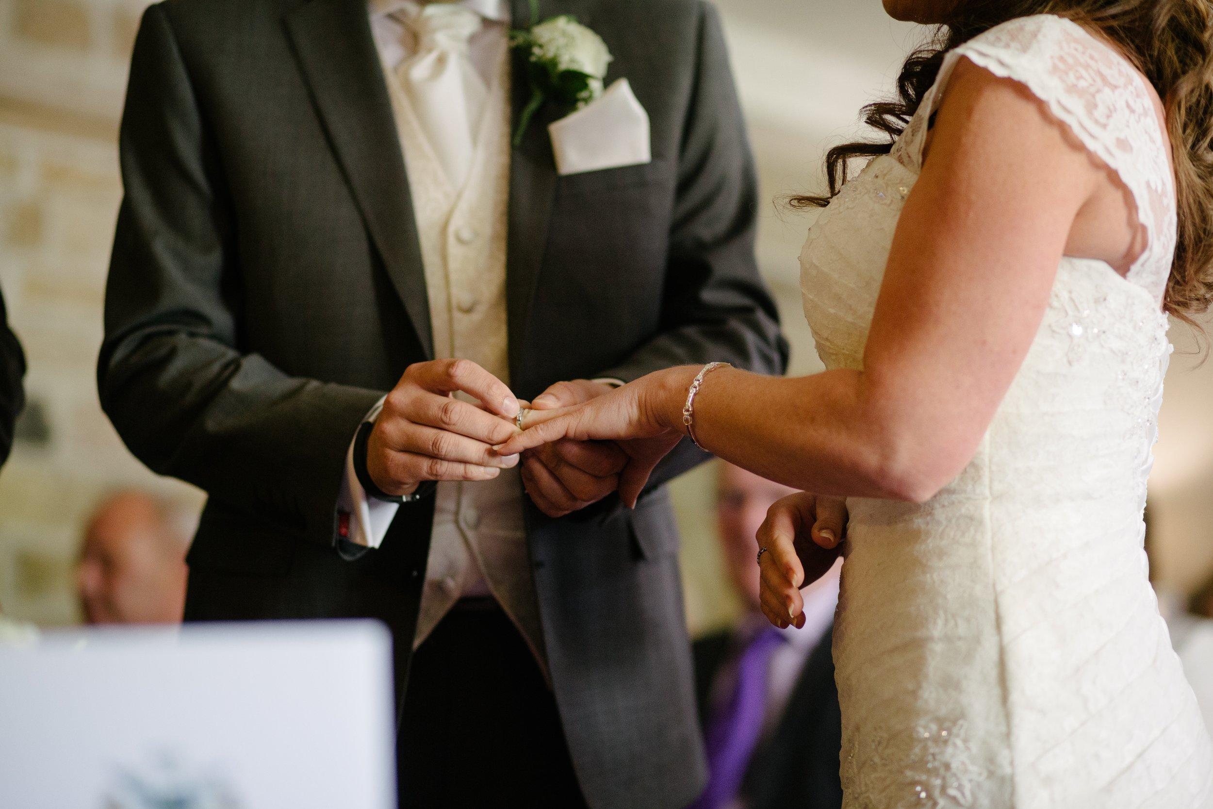 groom puts ring on bride's finger columbus, ohio wedding officiant