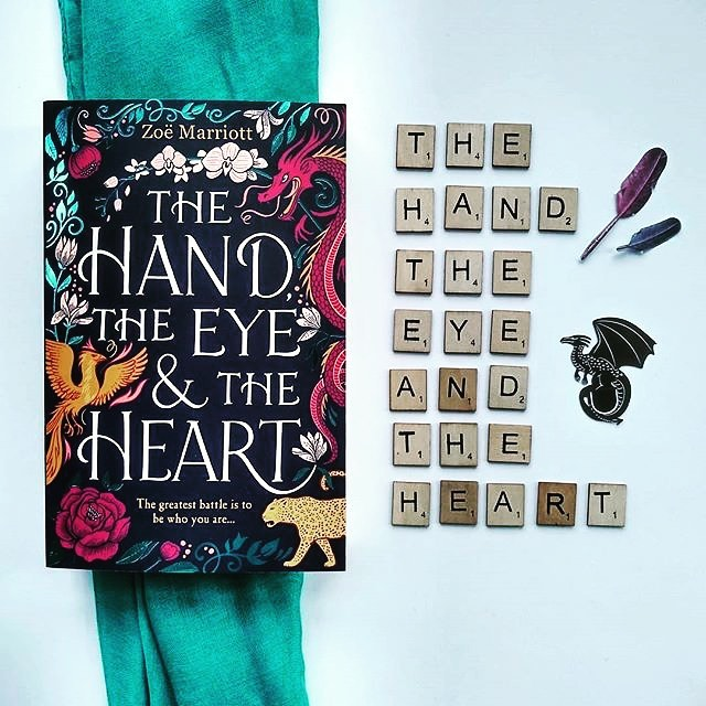 Reposting @literaryeditsinsta: What are you reading this week? We're reading The Hand, The Eye & The Heart by Zoë Marriott. Rooted in Chinese tradition and mythology, this novel forms a loose retelling of Mulan. . . . #TheHandTheEyeandtheHeart #ZoëMarriott #Fantasy #YoungAdult #YA #YABooks #Read #Reading #AmReading #Bibliophile #BooksofInstagram #BookstagramFeature #Bookstagrammer #Bookstagram #Bookshelves #BookWorm #Literature #Flatlay #Bookish #BookishFlatlay #Dragons #Gender #Queer #BookNerd #BookBlog #BookBlogger #LiteraryEdits #LiteraryEditsInsta